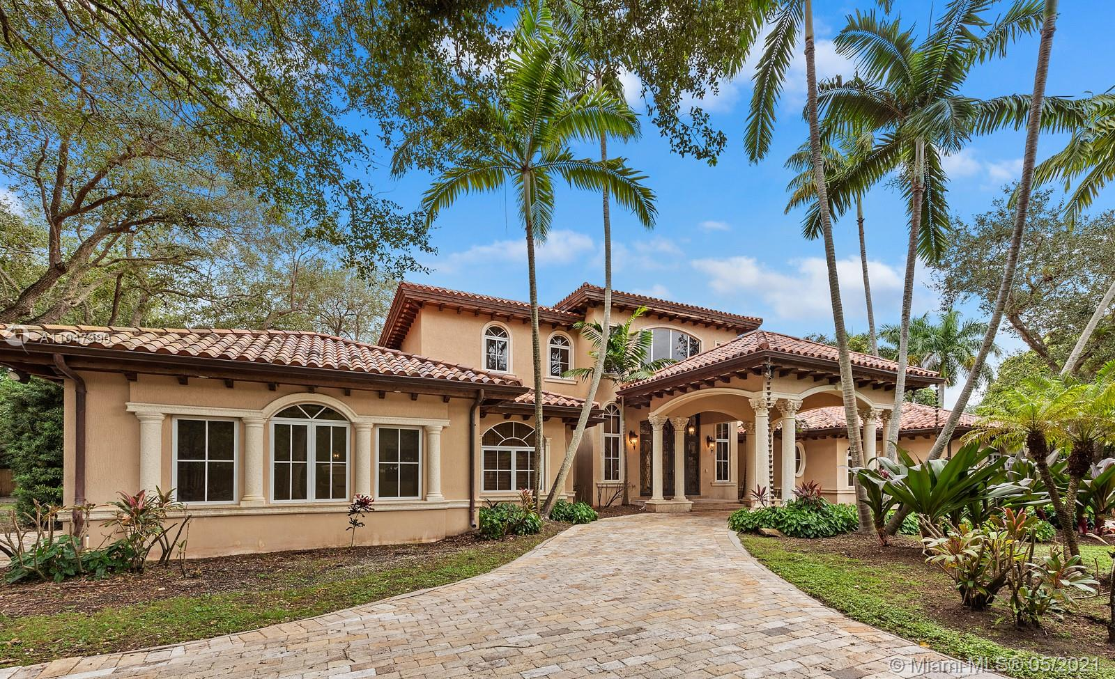 A Beautiful classic! This two-story Mediterranean estate home sits on a 38,000 Sq. Ft. gated lot in sought-after N Pinecrest, surrounded by gorgeous landscaping. The entrance has soaring ceilings with a staircase accented by classic columns—travertine floors throughout w/floor-to-ceiling windows. The master suite located on the first floor has a lavish marble bathroom and steam room. Upstairs there are four additional ensuite bedrooms. This home is perfect for entertaining with fantastic living spaces, including a formal living, dining, family/game room & chef's kitchen featuring all top-tier appliances. It offers ample exterior entertainment areas with modern integration and a resort-style pool. Additionally, the property includes a summer kitchen,4 car garage & guest/maid's room.