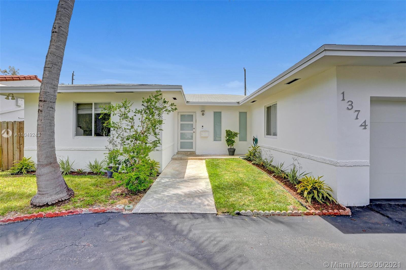 Upgraded 3 bedroom + den /2 bath in Normandy Isle. Great location, walkability and bike paths to the Beach just blocks away. Split plan layout with open living room, kitchen, spacious garage and brand new 320 SF screened in patio. Upgrades include: New roof in 2015, hurricane impact windows and doors; In 2016 new central A/C; in 2018 back yard fence; in 2020 master bathroom, new 80 gallon water heater, washer/dryer and insulated/hurricane impact garage door and opener. Circular driveway and great size back yard with fruit trees and space for a pool. A must see!