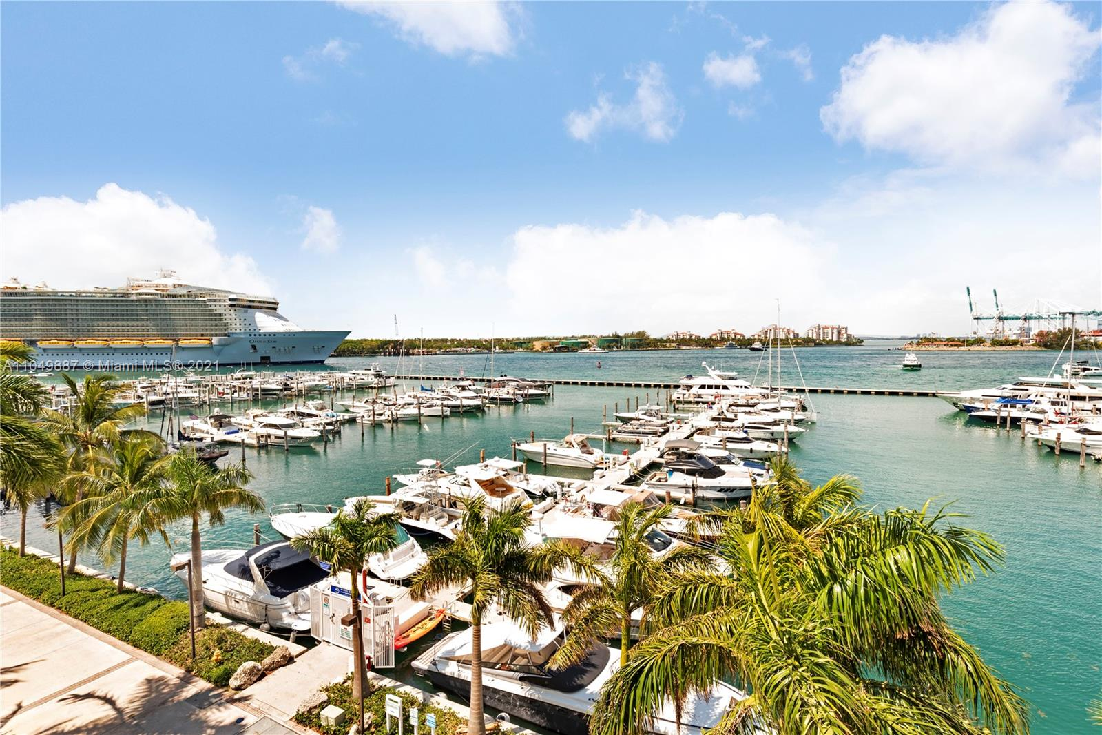 Charming direct bay corner unit in the Yacht Club.  Feels like a private home as opposed to being in a condo building. Perfect pied-a-terre for a second home or boat owner who would like easy access to the marina.  Unit can be entered either via the marina side or through the building.  One bedroom with small den that can be used for an office or day bed for guests/visitors.  Assigned parking space right next to the unit! All assessments paid for.  The yacht club is undergoing lobby renovations which will be complete this summer.  Tennis courts, pool deck, convenience store, hair salon, fitness center, pet friendly and flexible monthly rentals, 12 x per year allowed.