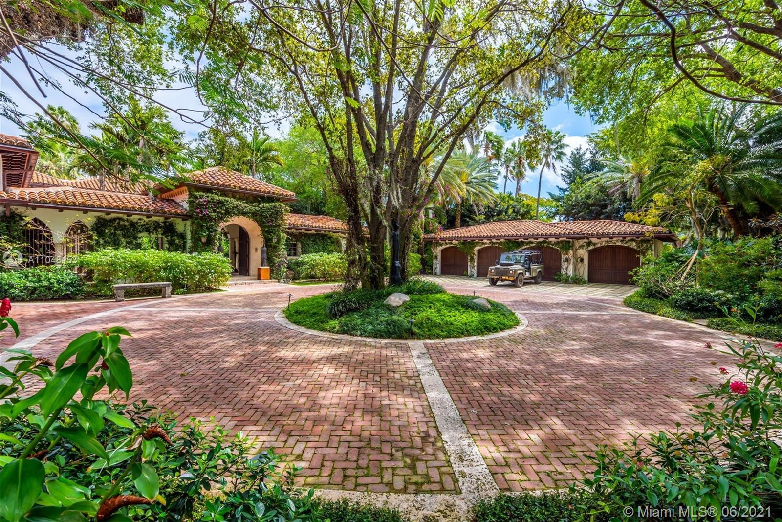 This Mediterranean Estate features 175' of direct waterfront overlooking scenic Indian Creek ideally situated on a rarely offered 1.1 acre lot double lot. This meticulously remodeled & expanded 1937 estate features state-of-the-art technological integration & boasts 9BR/11+2BA, a 22,000 gallon pool, pool cabana, koi pond, sculptured gardens, gym, spa, glam room with hair salon, wine cellar, library, safe room. 2 BD guest house, 2 guest apts, and a 100 foot private dock with a boat lift and a 3 jet ski lift. 4 Car Garage + 2 Car Garage.