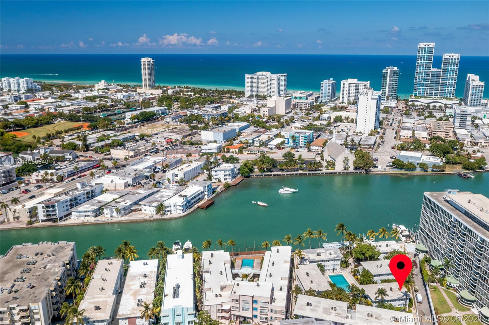 Waterfront Tropical Miami Beach with 30' Dock Available.  This two story 2 bedroom, 2 bathroom townhouse condo is nestled in a tropical boutique condominiums within walking distance to the Atlantic Ocean and Collins Avenue.  Restaurants and shops are all around this unique property.  Enjoy your over-sized second floor terrace for entertaining.  Walking in, you'll be immediately enjoy the high ceilings, and take advantage of owning a corner unit that's surrounded with windows brining in the natural light.  2 full sized bathrooms, one downstairs and the Master Bath, upstairs wall to wall windows and a walk-in closet.  Saving the BEST for last is the value. $300k