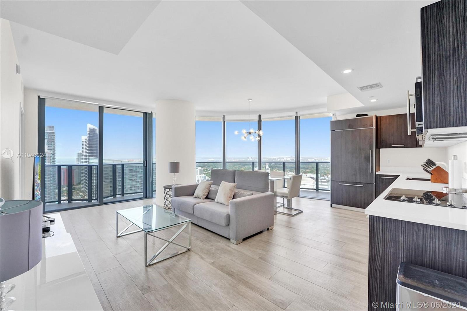 MOVE IN READY FURNISHED 2 bed/ 2 bath + Den in the Heart of Brickell. 2 Covered Parking Spaces (Owner Paid $20,000 for the Extra Parking) + Storage Unit. Beautiful Modern Kitchen and Bathrooms. Floor to Ceiling Windows with Wrap Around Open Balcony. Spectacular Views of the City Skyline and the Bay. 5 Star Amenities, Roof Top Pool, Concierge, Equinox Gym, Soul Cycle Studio, Valet, Kids Room, Club Room, Sustainable Community Garden and Much, Much More. Walking Distance to Everything Brickell has to Offer: City Center, Bars, Restaurants, Coffee Shops, etc.
