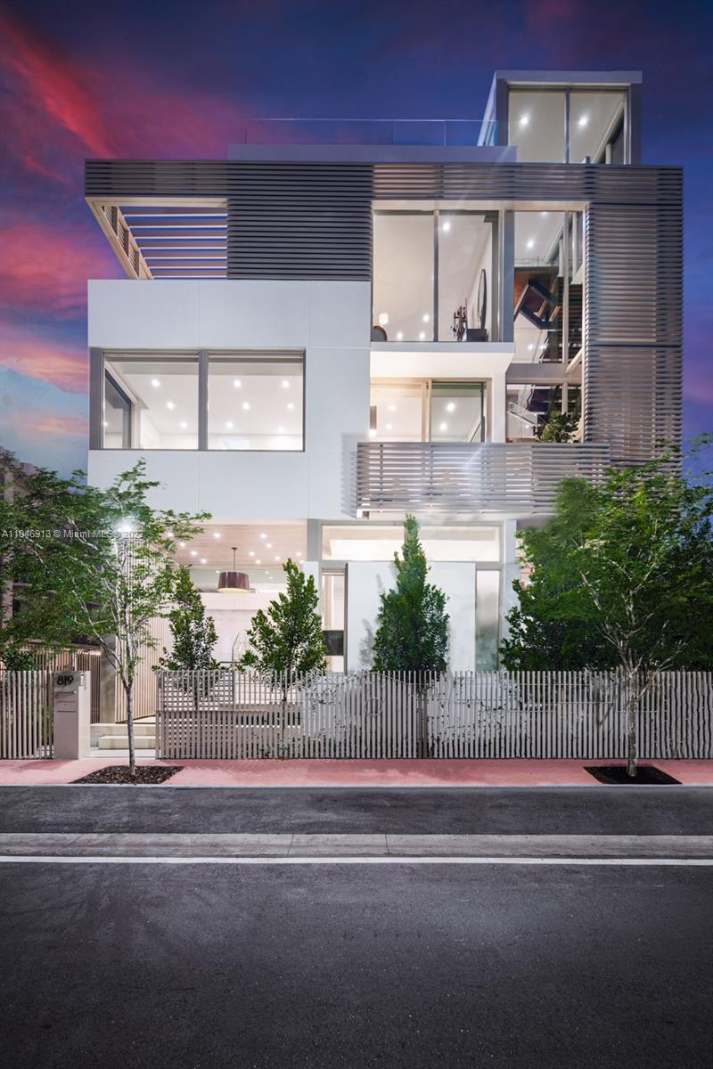 In a league of its own: Completed in 2021, this tropical modern South of Fifth single family home has no parallel. Conceived by renowned architecture firm Choeff Levy Fischman, the sculptural staircase, natural light and design aesthetics truly impress. With 3 bedrooms + gallery/media, 5 baths, this house boasts 10' ceilings. Take the elevator to the 1,250SF rooftop complete with a spa, retractable roof, Summer kitchen, TV, and jaw dropping Downtown views & magical Sunsets. Revel in interior details such as walnut flooring, speciality tile work, Wolf and Subzero appliances, custom bar, A/V automation, Lutron shades. Completed by a 2 car garage with commercial door + 2 car covered carport, & private entry. Live the SoFi lifestyle: mornings in the Park, lunch at Milo's, dinner at Carbone.