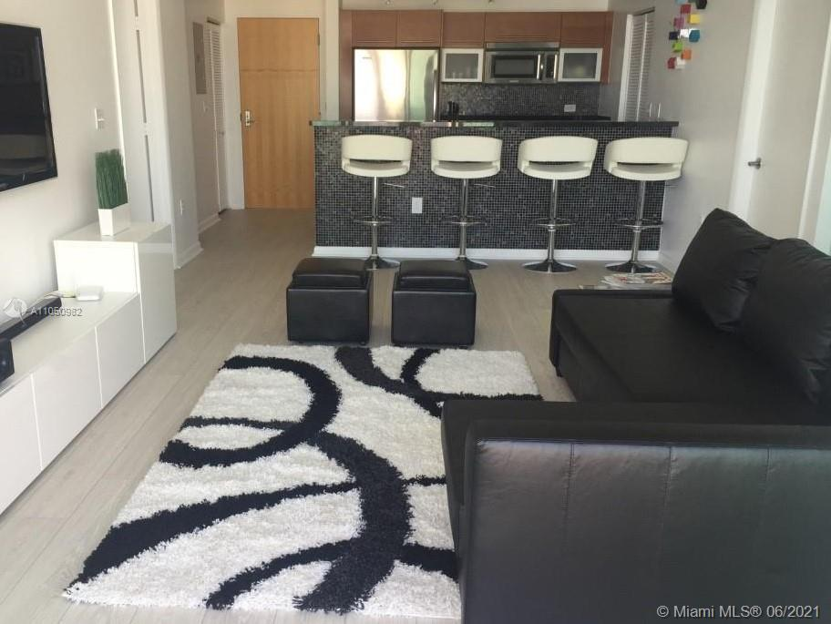 LOCATION LOCATION!! Wonderful 2/2 apartment at Vizcayne Condo.  Many upgrades, woodfloors, beautiful kitchen, NEW a/c unit. All amenities are 5 stars, including pools, gym, spa and more. Steps to Metro mover, Bayside, AA Arena, shops, restaurants, Parks and Museums.