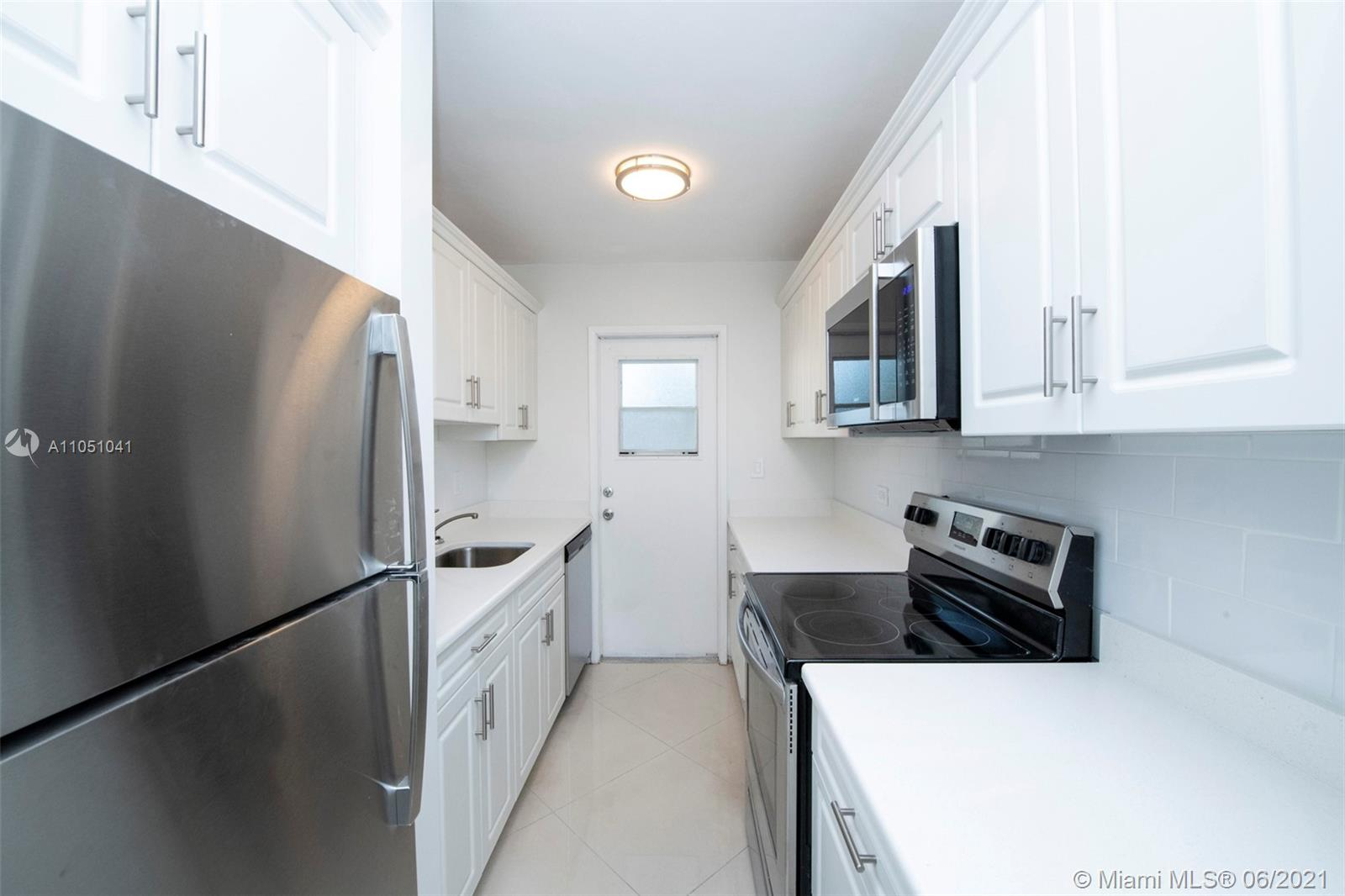 55+ community! Come step inside this hidden gem located in Cliff Lake Villas! This BEAUTIFUL 1 bedroom unit is conveniently located on the first floor and has been tastefully updated throughout! BRAND NEW updated kitchen with white wood cabinets, white subway tile backsplash, granite countertops and new stainless steel appliances. BRAND NEW white porcelain tile flooring. Updated bathroom! Impact windows with spectacular pool views. Enjoy the lush landscaping directly from your screened patio overlooking the lake. A true peaceful oasis located in the heart of Fort Lauderdale. Near restaurants, shopping, beaches & more all within walking distance. Walk to the intercoastal waterway and water taxi. Amenities include private pool, lake, shuffleboard and BBQ area.