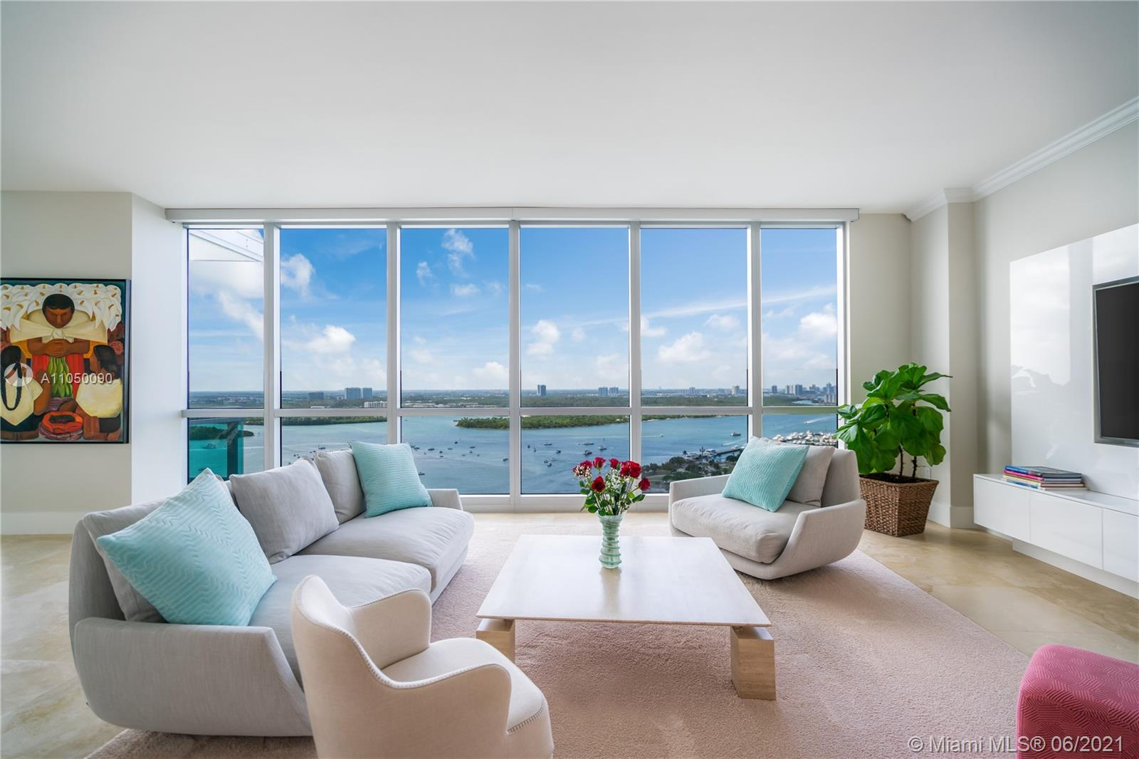 Stunning high-floor corner residence with private elevator and floor-to-ceiling windows. Enjoy breathtaking unobstructed views of the intracoastal inlet, the ocean coastline, and the Miami skyline from an impressive terrace. Residence 2404, located one floor below the penthouses, features a state-of-the-art kitchen with Poggenpohl cabinetry, fully-appointed bathrooms featuring the finest fixtures. Residents enjoy full access to Ritz Carlton resort amenities such as ocean and poolside service and an on-site restaurant and spa. Located minutes from Miami Beach's finest shopping and dining destinations.