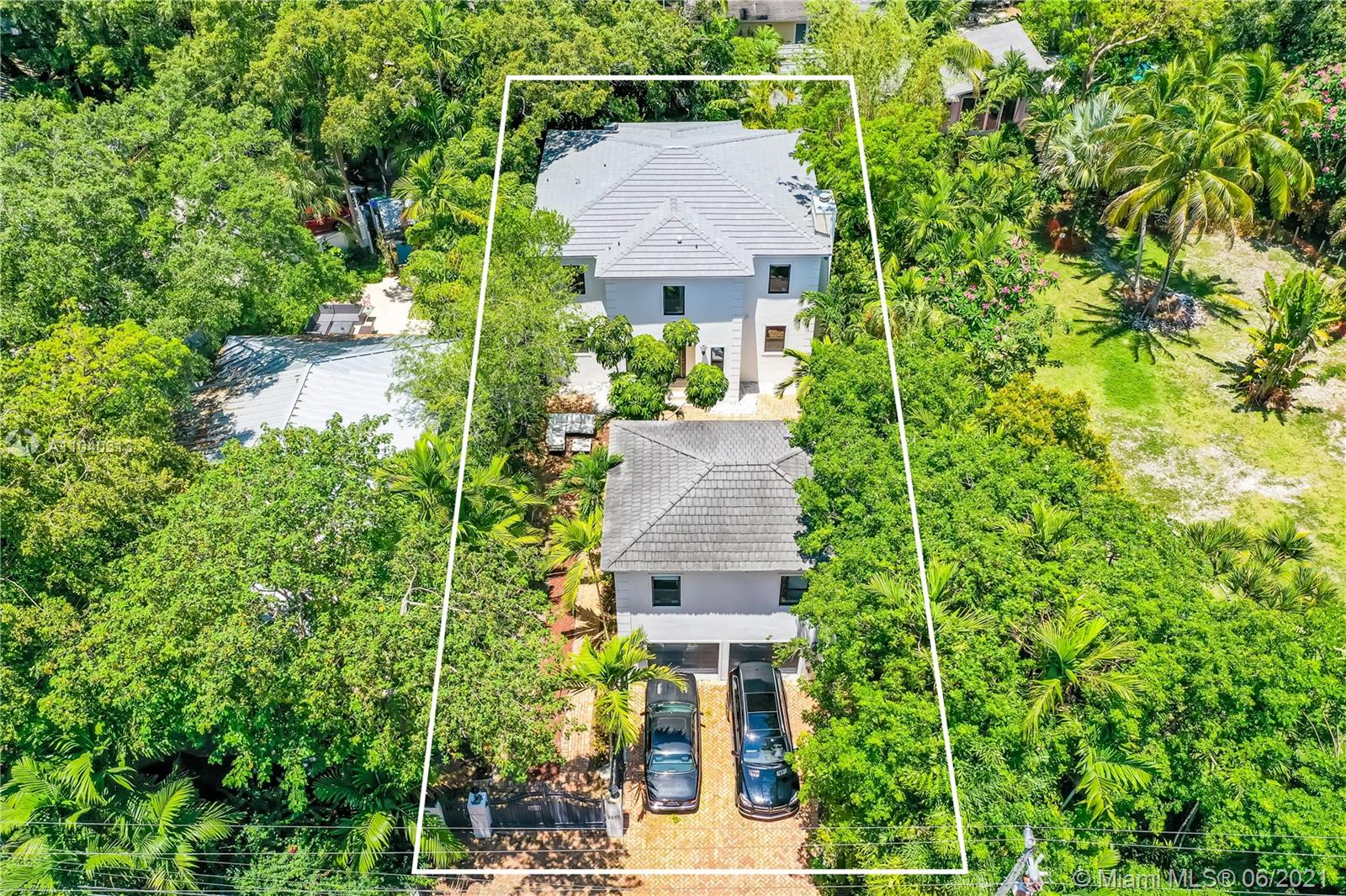Single Family Home in the heart of Coconut Grove. This is a must see contemporary beauty on a lushly shaded lot w/ approximately total Living area of 4,241 Sq. Ft. (per owner's information), ideal for entertaining in 2 stories, 4/3.5 on main structure + an adjacent 2/1.5 guest-in law facility. Enjoy the pool and/or open pit BBQ. Natural wood floors on 2nd floor rooms & marble floors throughout. Ample well designed kitchen w/ wood cabinets & marble counter top. Top of the line stainless steel appliances & pantry makes this an ideal haven for cooking/entertaining lovers. Property has new roof, freshly painted inside and outside, Impact door & windows (done less than a year).