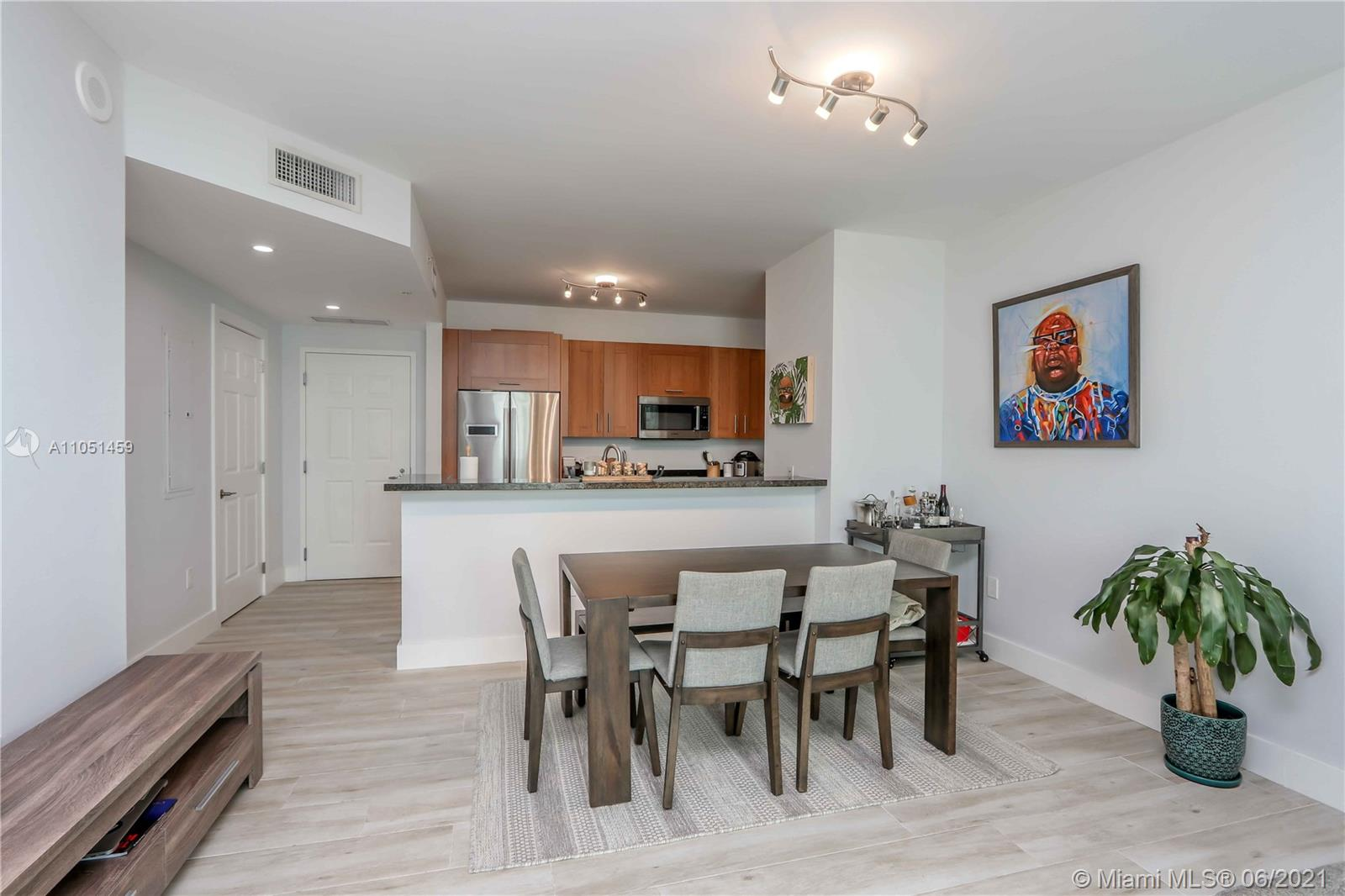 CORAL GABLES CONDO RIGHT ON THE PRESTIGIOUS PONCE DE LEON BLVD.  This beautiful 1/1 ½ unit offers high ceilings, chic tile flooring, elegant kitchen with Italian cabinetry, granite counter tops and stainless-steel appliances.  Bathroom has a roman tub and separate shower.  There is one assigned parking space to this unit. The unit has been updated to offer a beautiful, bright space with views of Downtown and Brickell. Catch the Coral Gables Trolley right outside your building door and take a two-minute ride to Miracle Mile, restaurants and/or shopping. The building is full of amenities: modern gym, event room, pool, doorman/security 24/7. Move in ready. Excellent condition. It's a must see!