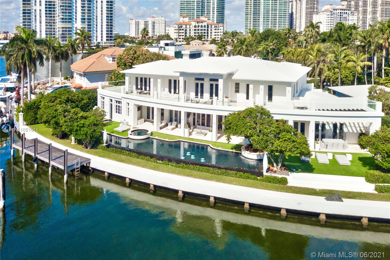 Golden Beach's finest waterfront estate with an impressive 188 ft. of pristine water frontage. This one-of-a-kind luxury residence offers the amenities of an exclusive resort with the inviting spaces of a home.  As you walk in, you are greeted with a grand double staircase, vaulted ceilings, and magnificent views along one of the widest bodies of water in Golden Beach.  Spectacular in-house full spa and gym with two saunas, steam room, and cold & hot plunge pools. Exquisite 100 ft. infinity edge waterfront pool with lushly landscaped outdoor spaces. 8-seat home theater. 900 bottle wine cellar, and executive built office. Expansive principal suite with dramatic walk in closets and stunning his and her baths.  Top-quality finishes throughout will impress the most discerning buyer.