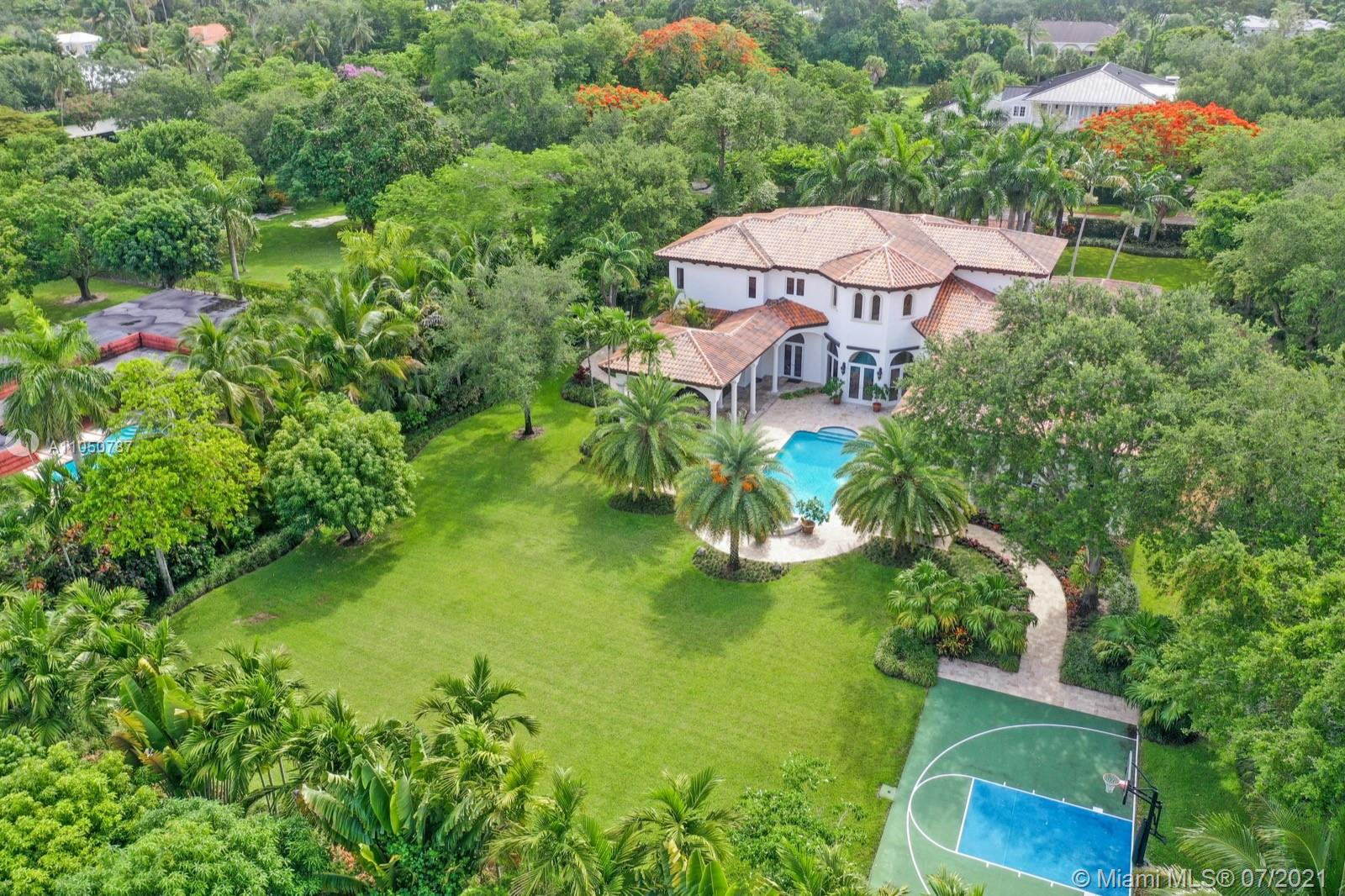 Great opportunity to own a coveted gated & custom 7 bedrooms/8.5 bathrooms estate w/ 3-car garage, on a deep oversized lot w/ custom design landscaping, located in prestigious N. Pinecrest. Some of the amazing features of this property are: Resort style amenities, including oversized pool and spa, 2 large, covered terraces with S/S built-in grill & bar, multi-sport court, gourmet kitchen w/Euro wood cabinets & Thermador appliances, family room w/bar & fireplace. Maids quarter, gym/media room, library/office, w/ 3 separate built-in desks, insulated & pre wired closet to be converted into a wine cellar. 2 story foyer w/ panoramic pool & garden views and much more. Walking distance from Gulliver Prep.
