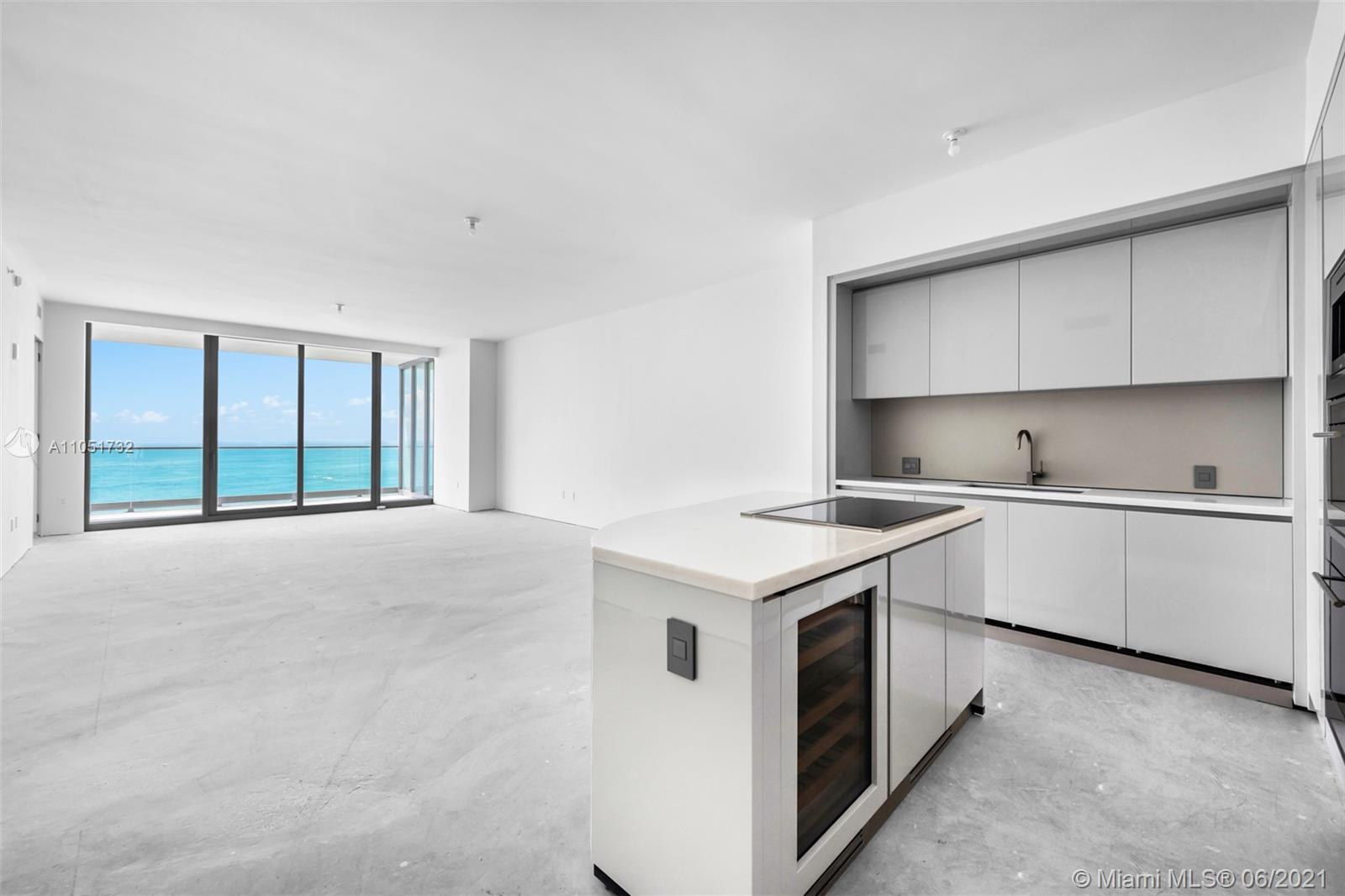 BEST DEAL ON THE BEACH. 4 BEDROOMS RESIDENCE IN NEW BUILDING FACING THE OCEAN. DESIGNER READY TO INSTALL ANY TYPE OF FLOORS DESIRED. FULLY EQUIPPED WITH HIGHEST QUALITY OF APPLIANCES IN KITCHEN, BATHROOMS FINISHED WITH BEAUTIFUL STONES ALL DESIGNED BY GIORGIO ARMANI HIMSELF. MASTER INCLUDES A WETBAR AND IMMENSE WALK IN CLOSET. INCLUDES SERVICES QUARTER/ CAN BE CONVERTED INTO 5TH BEDROOM.
