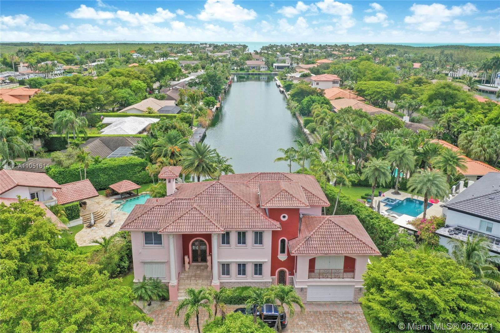 One of only a few end lot homes in Gables by the Sea, this grand 4,407 SF home sits at the end of the waterway with lush landscaping for the ultimate in waterfront privacy. At 12,500 SF, the lot is open and sunny, with water views in the backyard, a beautiful infinity edge pool, and large covered terraces both upstairs and downstairs for outdoor entertaining.  Inside, the spacious home boasts 12 foot ceilings, a large eat in kitchen that connects to the family room, formal living and dining rooms, and a separate game room. Each of the home's 5 bedrooms has its own en-suite bath, and an upstairs laundry room & kitchenette provide the ultimate in convenience. Gorgeous 2 story Mediterranean style home built in 2002 offers great frontage on Red Road w/quick access in & out of the neighborhood.