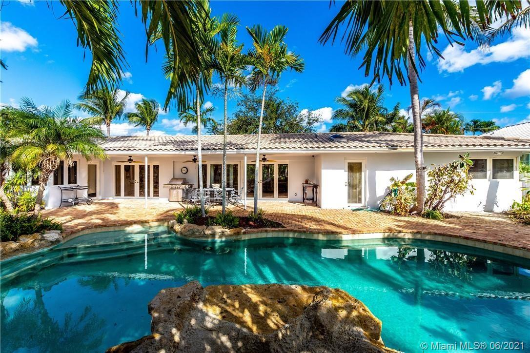 Bring your Boat!! To South Florida Prime Location . This spectacular direct waterfront home is situated on a spacious lot with plenty of room. Perfectly tropical South Florida location is a boater's dream – from your dock to the ocean in just few minutes! Did I mention the 101' dock that's waiting for you? As you approach this waterfront beauty at the end of the street you are greeted with an expansive circular driveway All on one level, this home offers an Upgraded throughout with hurricane impact windows and doors. Amazing backyard with heated pool and spa and gorgeous water views.