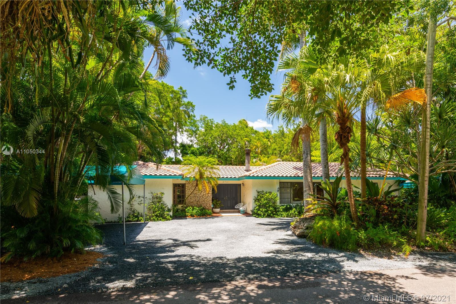 This highly sought-after Coconut Grove address is the location of this beautiful 5-bedroom home with more versatility than can be imagined. It provides a near perfect balance of living and working spaces. All the bedrooms are oversized with generous closets. The main suite has both a lavish, remodeled bath as well as a bonus room which can serve as a gym, studio or office. The elegant living room with its classic fireplace adjoins a remodeled kitchen and dining area that is the heart of the home. A generous in-law suite, office and family room provides additional room for everyone to live, work and play. The ideal U-shape floorplan provides a view of the sparkling pool from almost every room in the house. Located in Flood Zone X, no flood insurance is required. A Very Special Home.