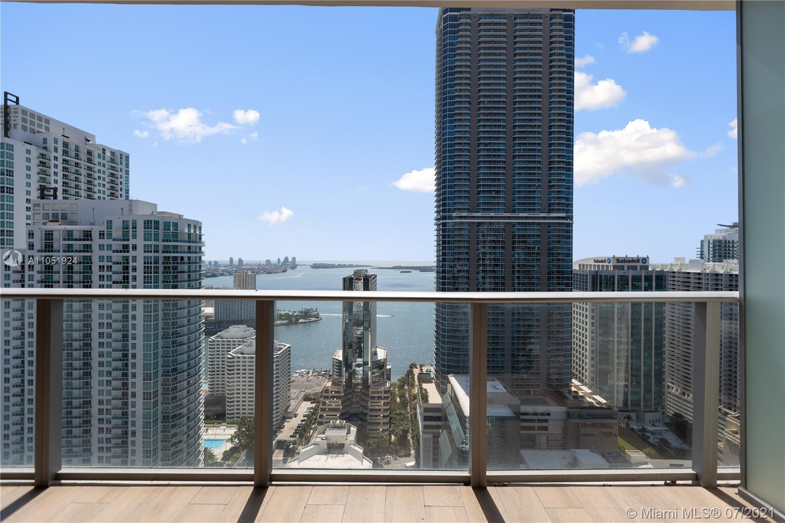 Incredible unit on the 41 floor. Spectacular view of the Ocean & Miami city skyline. 2 bedroom, 3 full bathroom, plus Den with full bathroom, to use as a 3rd guest bedroom or kids room. Private elevator opens directly to the unit. Second bedroom can be used as bedroom or as an office too. Top of the line kitchen & appliances. Over 50k on upgrades such as porcelain floors, spacious kitchen, shades & more. Building is famous for 2-level activity center of superior amenities, rooftop & indoor pools with bar/grill, spa, fitness center, running track, indoor basketball & squash court, kids water park, bowling alley, E-Golf and much more! Interior staging project included with optional shoppable furniture moodboard.