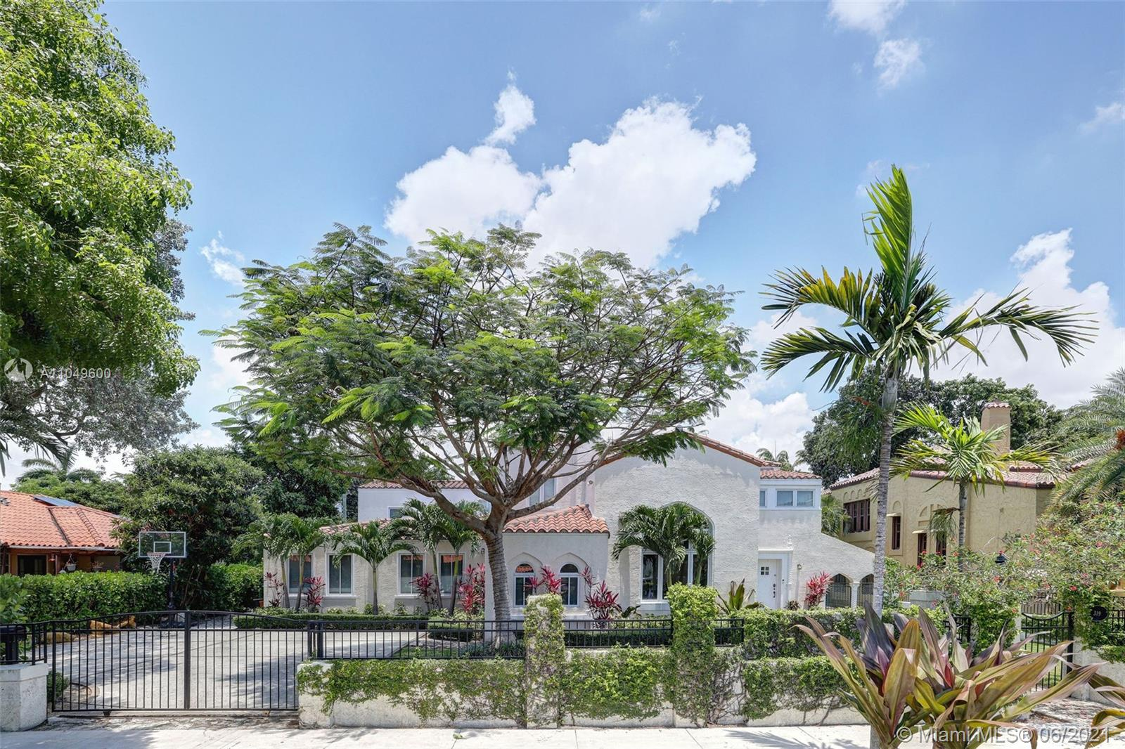 Spanning 5,123 SF, this 2-story home offers 6 beds, 4.5 baths, and features true Coral Gables charm with Cuban tile, Cypress doors and coffered ceilings. Foyer entry, Formal Dining, and impressive Living Room with soaring ceilings supply luxurious elegance to any gathering. Custom eat-in Kitchen includes a Butler's Pantry and high-end appliances. Master Suite features sitting area, walk-in closet, steam shower and separate tub. This gated 13,917 SF lot boasts whimsical courtyards, a covered patio, spacious yard with heated pool and spa. Large Family Room. Additional features include Breakfast Nook and Office. Ideal for comfort and easy entertaining alike. Designed by award winning architect, Jason Chandler. Minutes from Downtown, Coconut Grove, shops, eateries, and A+ rated schools.