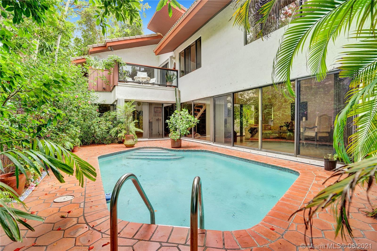 Unique opportunity to live in one of Miami's most prestigious streets, Historic South Miami Avenue! Very private home located in the secluded gated community of Brickell Forest with only 7 homes. This property features 4 bedrooms plus den and 5 bathrooms and two car garage. Tropical pool/patio area with lush landscaping, that gives a relaxed and Zen atmosphere. Brand new roof, 2021 and newer beautiful wooden floors in the bedrooms. Conveniently located with easy access to I-95, minutes away from the Airport, Coconut Grove, Coral Gables, Downtown Miami, the beach and nice stroll to the Financial Brickell area and its famous restaurants and shops. An oasis close to everywhere!