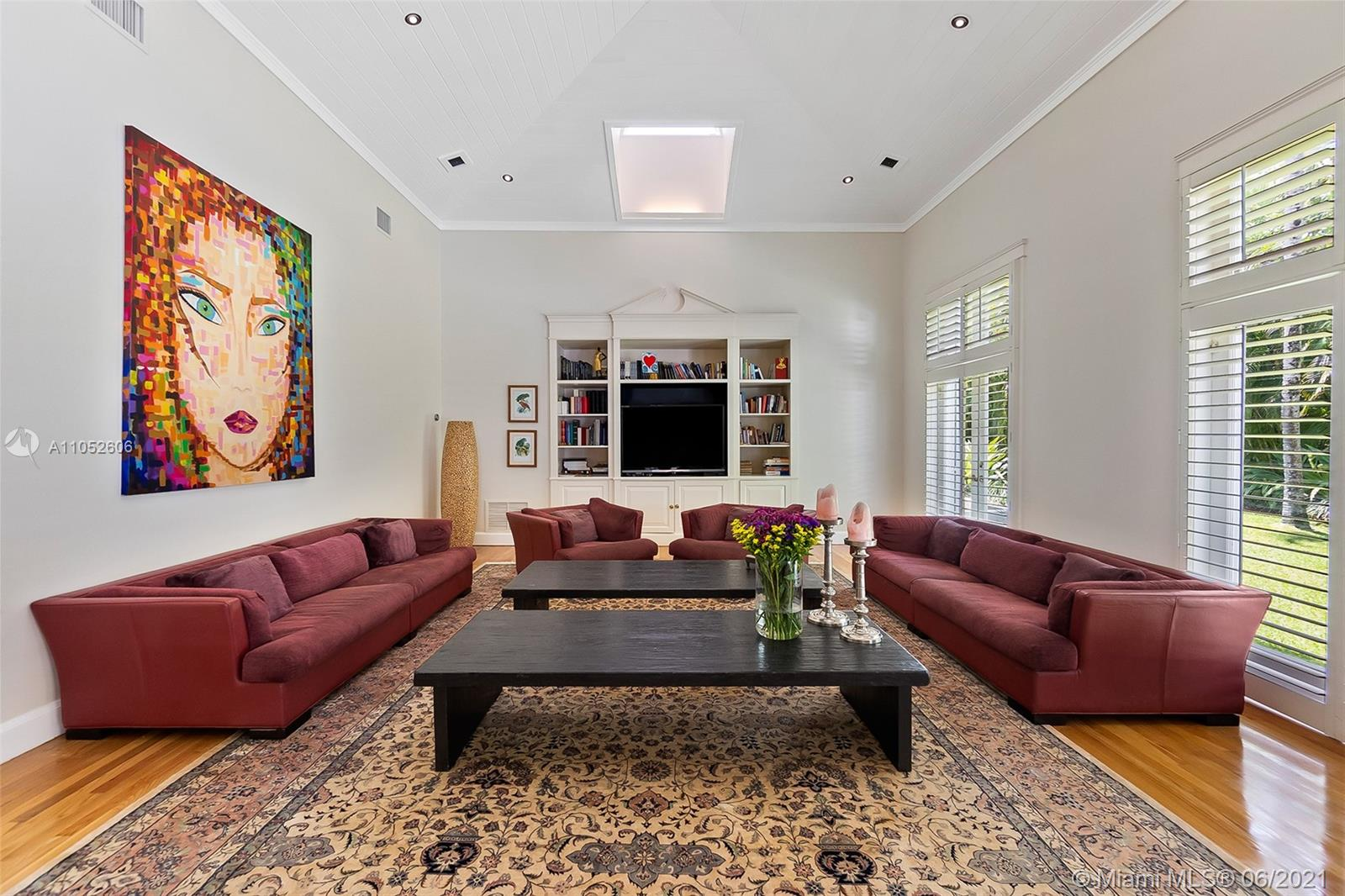Located on a quiet cul-de-sac in Coral Gables near the Ponce-Davis area, this beautiful home is filled with natural light and understated elegance. The 5b/6b main house encompasses 8,000+sf and features formal living and dining rooms, spacious family room with high vaulted ceilings, customs built-ins, skylights, renovated kitchen with high-end appliances, impact windows and doors and oak flooring. Separate and newer 3b/2b guesthouse with kitchen is ideal for in-laws, grown children or staff. Outdoors the 38,000+sf lot is an oasis with palms, fruit trees and orchids incorporated throughout serving as the backdrop for a lavish pool surrounded by a stone patio perfect for family gatherings and entertaining. A three car garage and whole house generator complete this incredible offering.