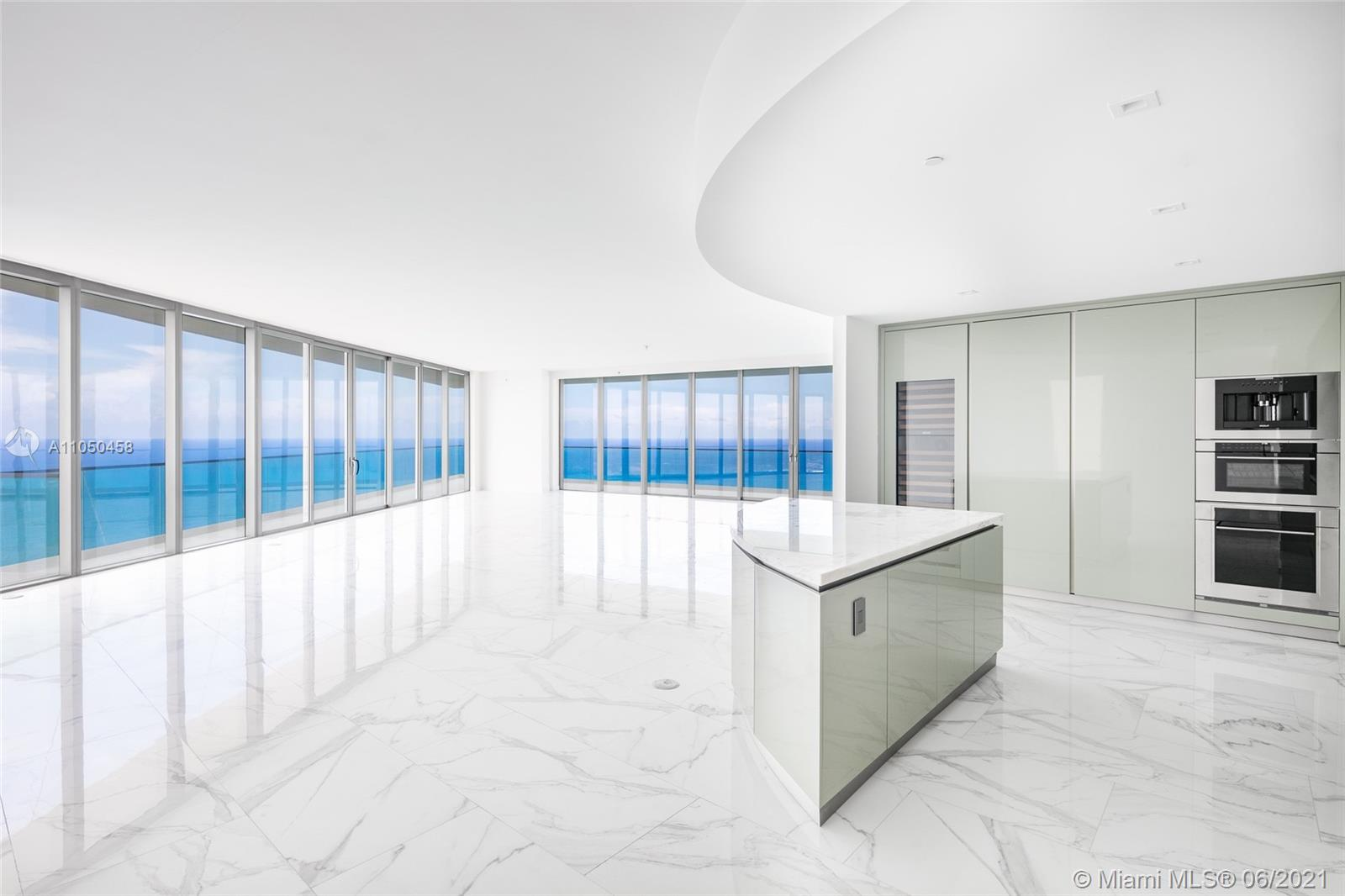 """Highest Floor Available in the Best Line """"00"""" at Residences at Armani Casa. Residence #5100, finished with oversized Italian tile, is the largest corner layout (4bed/5.5 bath + Service) and the only line with a private foyer. Enjoy breathtaking direct ocean and sweeping intracoastal views from all areas. The interior living space is spacious, modern & elegant with 10 Ft ceilings. Expansive 10 foot-deep balconies with summer kitchen create a seamless expansion of living space into the fresh air. Sleek European kitchen. Smart residence w/digital thermostat. Impeccable main suite with midnight bar, his & hers baths with breathtaking ocean view. Armani Casa residents can indulge in beach service, full service spa, private restaurant, game room, cigar/wine room, & child's play room."""