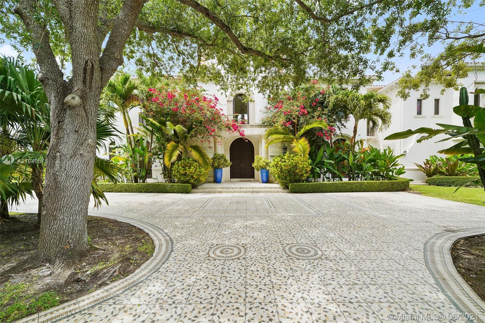 Located in one of Miami's most prestigious neighborhoods, Ponce Davis. This palatial estate with 8 beds, 10 full and 2 half baths evoke Mediterranean Revival grandeur. Spanning 10,000+ sq ft, plus separate guest house, with arched walkway courtyards, covered terraces and open balconies overlooking the heated pool and spa. Residents are welcomed by a grand atrium, winding staircase and coffered ceilings. Impressive gourmet kitchen with high-end appliances. Luxurious Master Suite boasts large sitting area, private balcony, his/hers walk-in closets, spacious bath with separate shower and spa tub. Designed for large scale entertaining with oversized formal dining and family room. Maids quarters. Additional features: media room, elevator, 4 car garage, full house generator and summer kitchen.