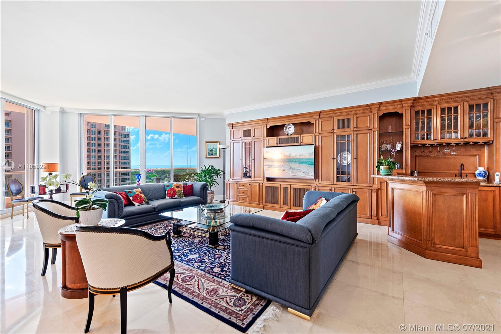 Large (3165 sft), high floor 3/3.5 condo in the prestigious Gables Club, a luxurious, waterfront, service focused condominium with beautiful grounds and 24/7 security. Stylish 11F was lovingly decorated with many upgrades by an owner designer. This condo will make you feel like you are living in a single family home plus have incredible views from each room of the eastern bay, city, and sunset over Cocoplum and the Gables.  The unit has hurricane windows out to large balconies on all sides. Enjoy resort-style amenities; spa, 2 pools, fitness center, salon, private restaurant & lounge, tennis courts and putting green. 11F comes w/ 2 covered parking spots, electric vehicle charger, and air-conditioned storage. Furniture is available for sale. Kindly schedule a private showing.