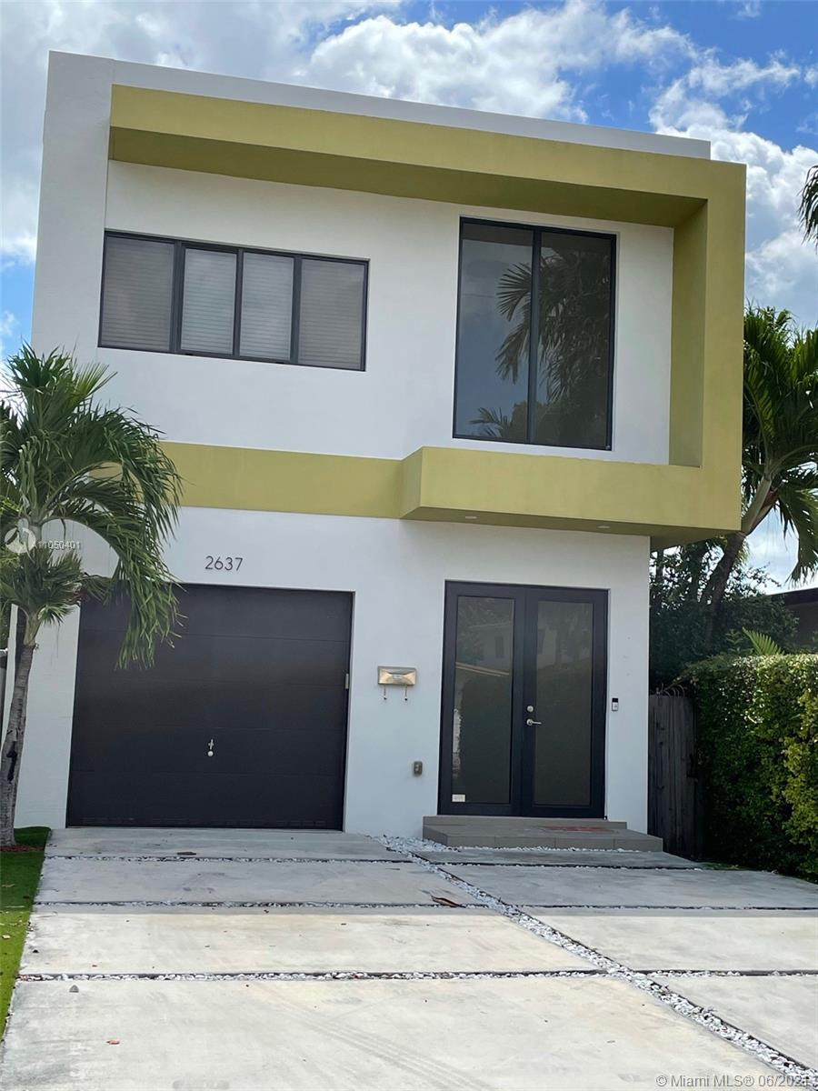 This is a FREE STANDING town house that is ready to become your forever home!! It contains 2,336 sq ft and was built in 2015. It features 3 spacious bedrooms, 2.5 bathrooms with walk in closets. All three bedrooms are located upstairs and a laundry room. The patio is very easy to maintain as it has artificial grass, turf. A large one car garage with storage loft. Up to 4 cars can be parked in the driveway. Italian wood tiles through out the house, dark wood cabinets in bathroom and kitchen, stainless steel appliances, quartz countertops.