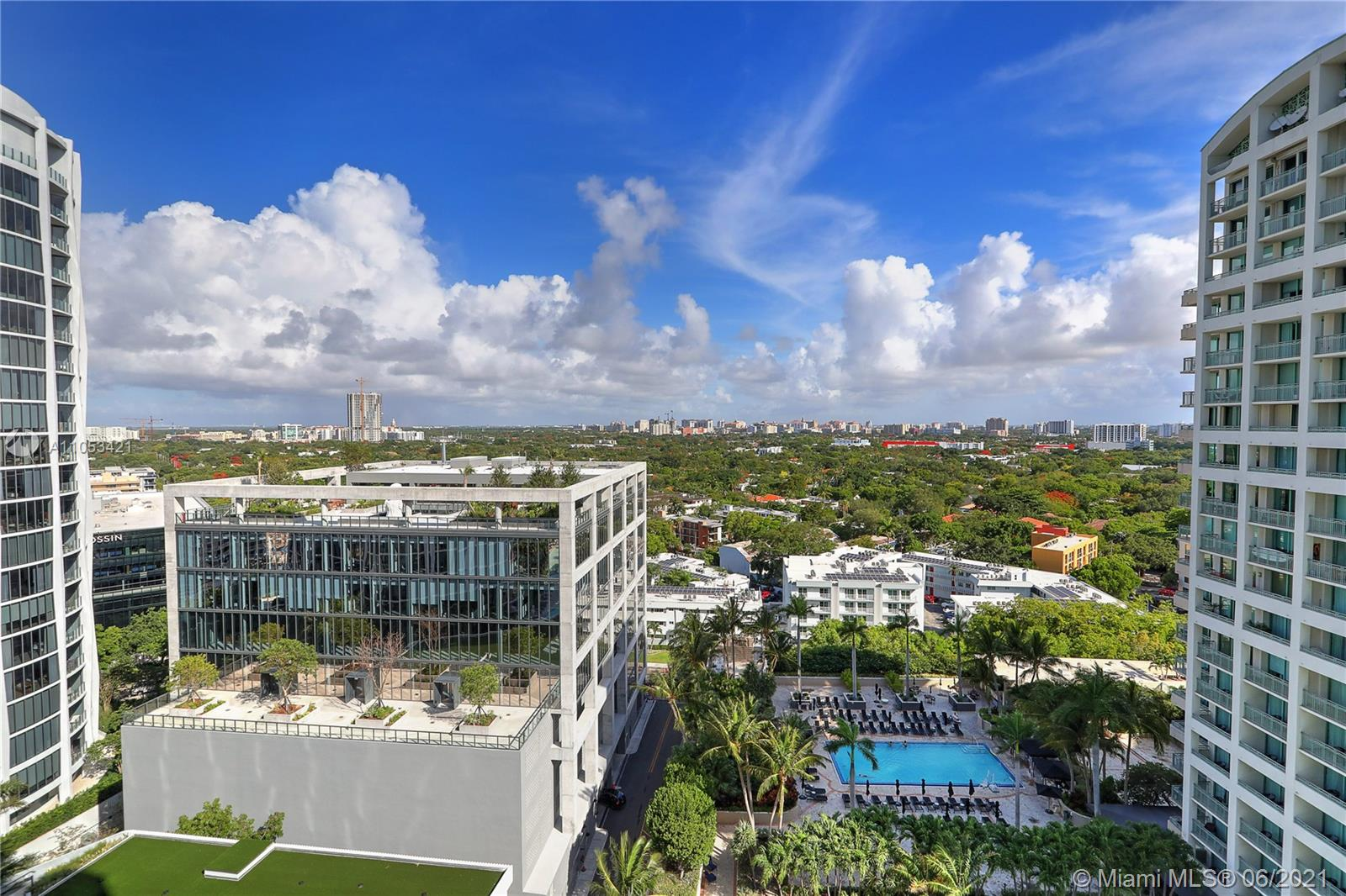 Enjoy the luxurious lifestyle and amenities of the world renown Ritz Carlton. This beautiful 2BR, 2.5BA, features a bright open dining/living area and a split bedroom floor plan. Private balconies off each bedroom and one off the main living area, great for entertaining. One of the most sought after locations in Coconut Grove. This impeccable unit has stainless steel appliances, marble baths, wood plank ceramic tile floors, unobstructed views of Coral Gables/Downtown skylines and exquisite sunsets. Amenities include 2 pools, full service spa, restaurant and bar, 24 hour room service and complimentary valet parking. Walk to dining, shops and parks. The name Ritz Carlton Residences sets the standard for luxury and service throughout the world.   A MUST SEE!