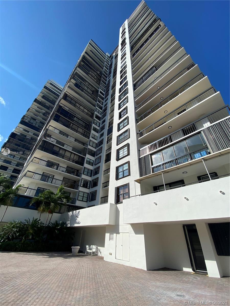 Beautiful, clean Centrally Located with the most beautiful BAY view in town!!!!. this unit has an enclosed balcony with impact doors. Community is gated and has resort style amenities such  Tennis Court, Gym, Jacuzzi, pool, kids area, Grocery store, conference room, Party room and a HAIR SALON!!!, you don't need to get out of the building.  it is  beautiful and well maintained!! call listing agent  now to schedule a showing!!!!