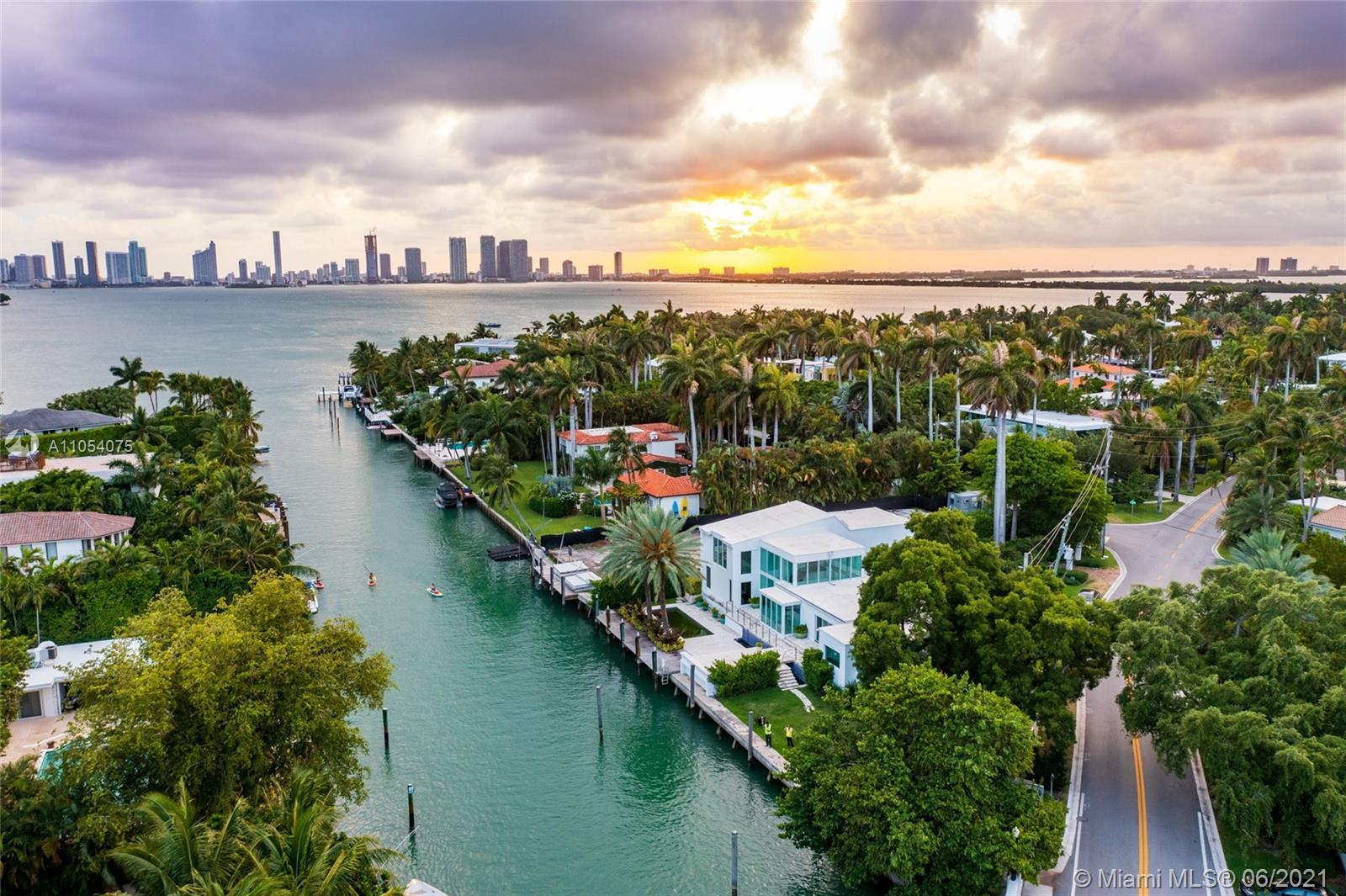 170 ft of private waterfront w/ direct access to open Biscayne Bay. Oversized 14,875 Ft lot rarely available, with mature Palm Trees & landscaping. Ability to have yacht on private dock & not obstructing views from home rarely possible on a single lot. Contemporary & architecturally significant home is 4,049 Sq Ft. 24 Hr. guard gate on the prestigious Sunset Island III. Walking distance to the Sunset Harbour neighborhood; the best of Miami Beach just outside the gate. Easy to show by land or water.