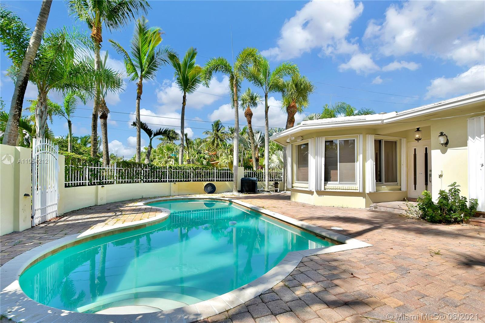 Charming beach home with lush landscaping, spacious outdoor area and pool on a private corner lot, just steps to Lauderdale Beach. The home features a great open spacious floorplan with three en-suite bedrooms and a garage. This is an amazing opportunity to live in a low-key beach neighborhood with no Hoa. The perfect opportunity to build your multi-million dollar home or turn to vacation rental.