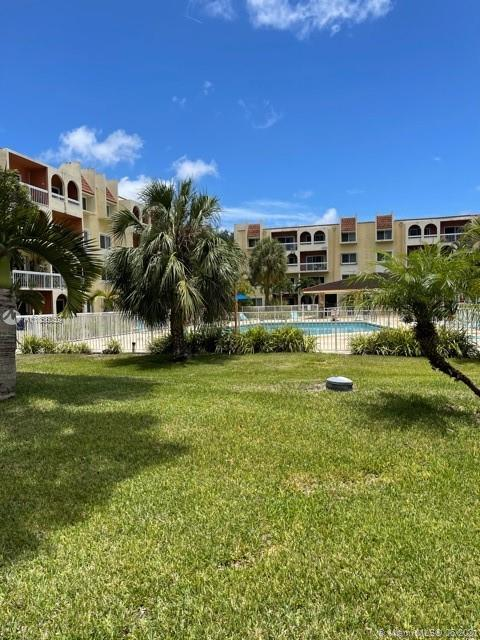 EASY TO SHOW! A cozy 1 bedroom, 1 bath, with beautiful garden court view and private screened in balcony with the view of the pool. This charming home features wood floors and is located near the laundry room. Just minutes from Dadeland mall.