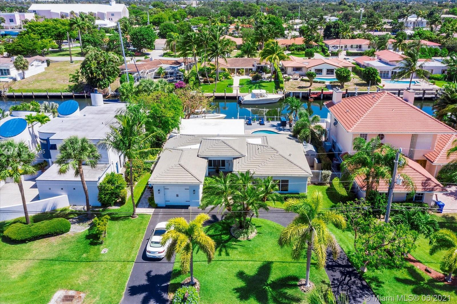 Boater's Dream Home! 87 feet of waterfront on one the best canals south of the Inlet! Tropical Paradise! Private dock with 14000 LB Boat Lift , 35 AMP electric and water service , sea water for the bait! NO BRIDGES! Direct ocean access in less than 10 minutes. This house has it all... South Florida Prime Location . Completely remodeled! This spectacular direct waterfront home is situated on a spacious lot with plenty of room. Perfectly tropical South Florida location is a boater's dream ! All on one level, this home offers an Upgrades throughout with hurricane impact windows and doors. Amazing backyard with pool and spa and gorgeous water views. Bring your offers , this house will not last! Ready to move in! PLEASE CALL LINA FOR SHOWINGS (954)612-0236