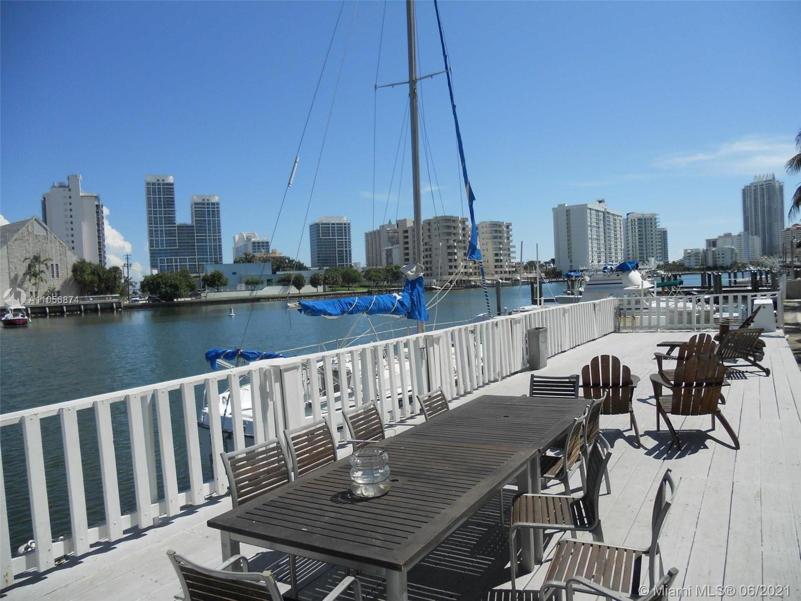 BOATERS HAVEN -- 2/2 townhome in the waterfront community of Tropical Resort Condominium in Miami Beach. A luscious sanctuary with bathrooms previously renovated with Italian tile, large master bedroom with walk-in closet and private-rooftop patio/balcony with garden view, large second bedroom, and a large living/dining room with access to the back and front patios. The unit is spacious and improved with Italian terracotta tiles on the first floor and bamboo floors on the second floor. Ample amounts of natural sunlight, and a European-style kitchen with all necessary appliances. This quaint waterfront community includes access to a waterside dock on the intercoastal, a swimming pool with lounge chairs, and laundry facilities on site. TV Room could be converted to a third bedroom.