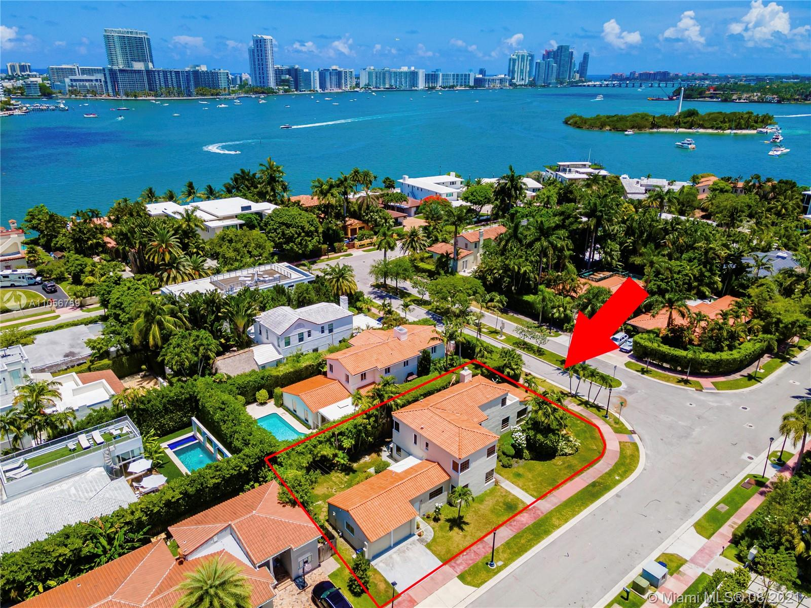 Prestigious Venetian Causeway - Rivo Alto Island - Classic 1936 Art Deco Home awaits your special vision. Large Corner Lot - minutes to Sunset Harbour, Lincoln Rd dining, shopping, fitness & more. Architectural features include: high ceilings, deco details, archways, moldings, original Spanish tile & wood flooring. Bedrm w/en-suite baths. 4 BRs (2 principal suites) + Florida room, formal DR, large kitchen & LR w/fireplace. Off utility room, a 2 car garage has been enclosed, finished & adds substantially to under A/C living space - may be used as separate guest quarters. Updates made to electric, plumbing, roof & 3 Central A/C units. Room for a pool. Best value today on the Venetian Islands. New Home across the street sold for approx. $20 Million. Check out Matterport virtual tour on link.