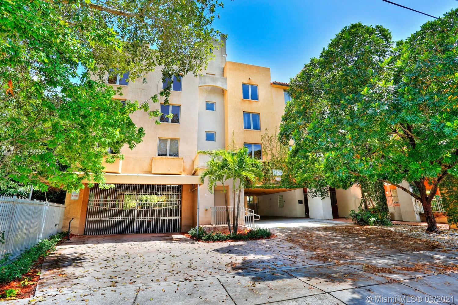 With over 800 square feet of light and bright interiors, this corner unit is impeccably maintained.  Boasting impact windows, washer/dryer, tile throughout, updated and open kitchen layout with stainless steel appliances,  unit with walls of windows overlooks serene gardens.   Dixie Grove is located near the Center Grove with its chic boutiques and wonderful restaurants.  Includes one assigned,  covered parking space. No pets allowed.