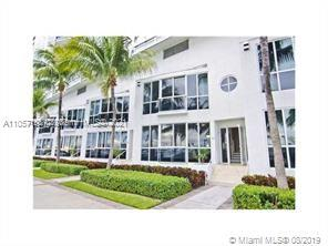 GREAT INVESTMENT! Beautiful townhome w/the best upgrades including solid teak wood floors & stainless steal appliances. A split level oversized one bed with stunning views over the marina facing sunset the city. Park directly behind unit. Great location with a short stroll to the beach!