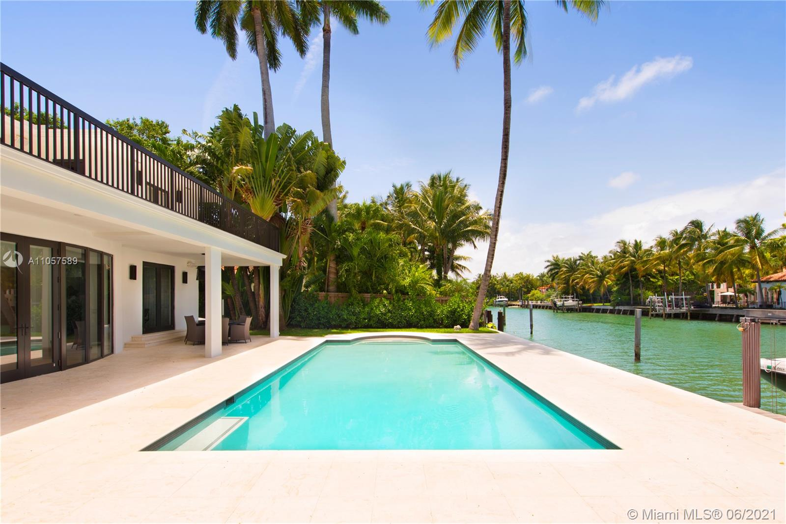 Located in the highly exclusive Sunset Island, this impeccably designed waterfront is your next turnkey destination. You will find yourself in an oasis filled w/beautiful scenery around the corner of the dynamic Sunset Harbour lifestyle. Every detail of this home was reconstructed to a perfect balance between Modern & Deco. Main floor features a spacious living room w/vaulted ceilings that leads to the pool & boat dock. State of the art media room for those comfortable movie nights & 2BR w/large bathroom also downstairs. Master bedroom on the 2nd floor opens to the terrace where you can enjoy sun all day & another large ensuite bedroom. Wood flooring throughout, custom designed kitchen w/Miele appliances, custom closets by Innerspace & electronic blinds, make this Smart Home easy to enjoy.