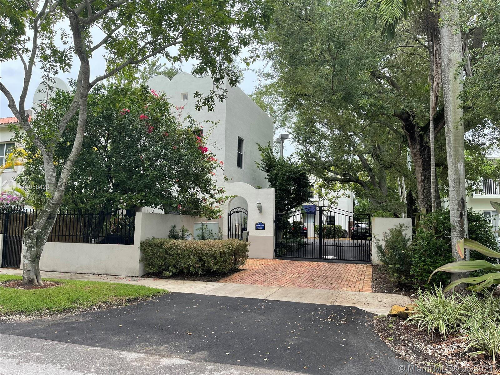 Fantastic location in the heart of sought after Coconut Grove. Perfect starter home in a quiet and gated community. Great 2/1.5 townhouse with private patio ideal for outdoor living, washer/dryer in unit,  tiled and wood floors throughout, accordion shutters, and 1 assigned parking in front of unit. Don't lose this opportunity, unit won't last! Easy to show.