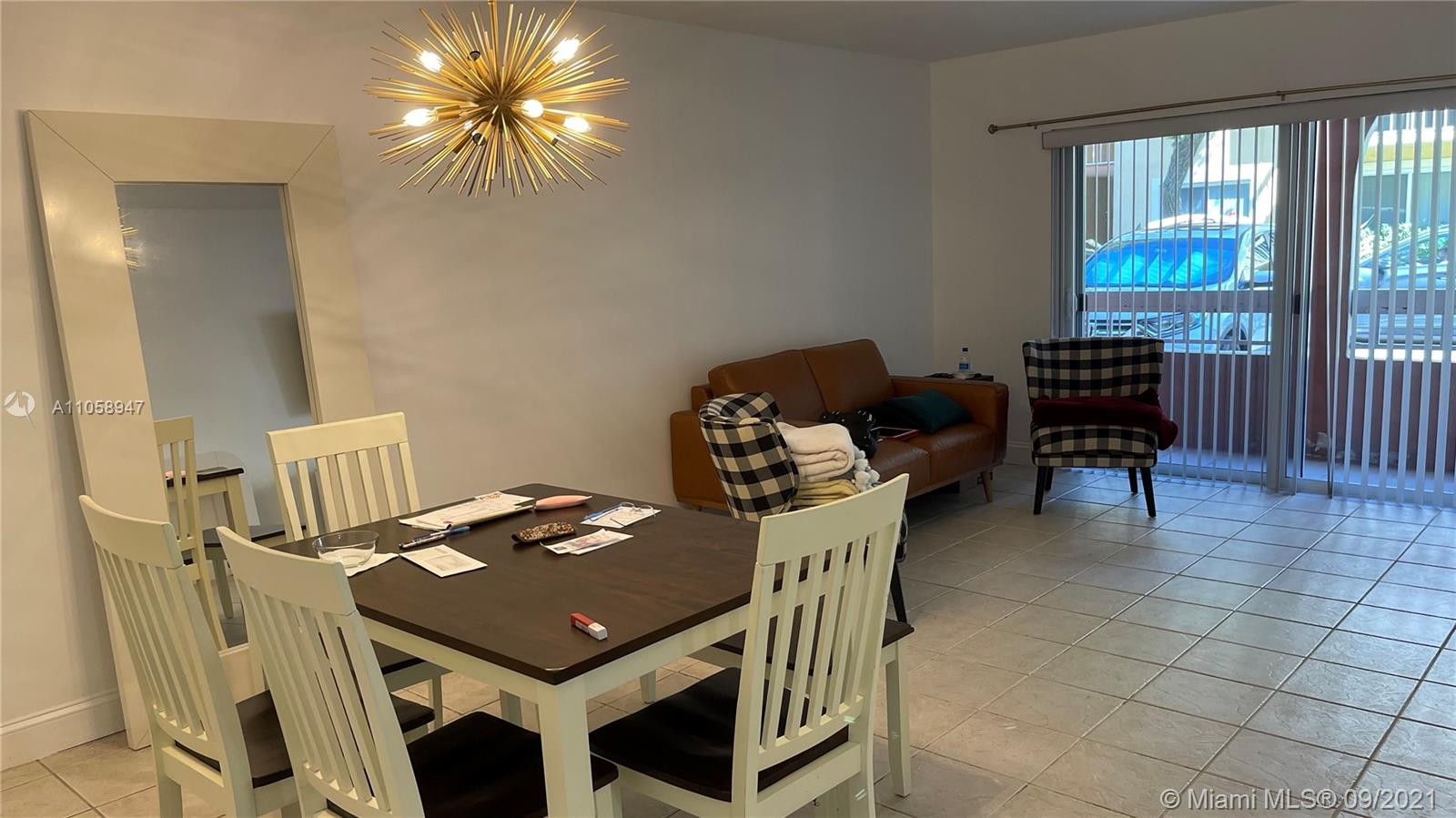 Village of Kings Creek, first floor, corner unit, 2 bedrooms and one bathroom. tile floor through out, impact windows and  impact patio door with balcony. 24 hours patrol, great management, close to US 1,Metrorail, Dadeland mall and right off HW 826