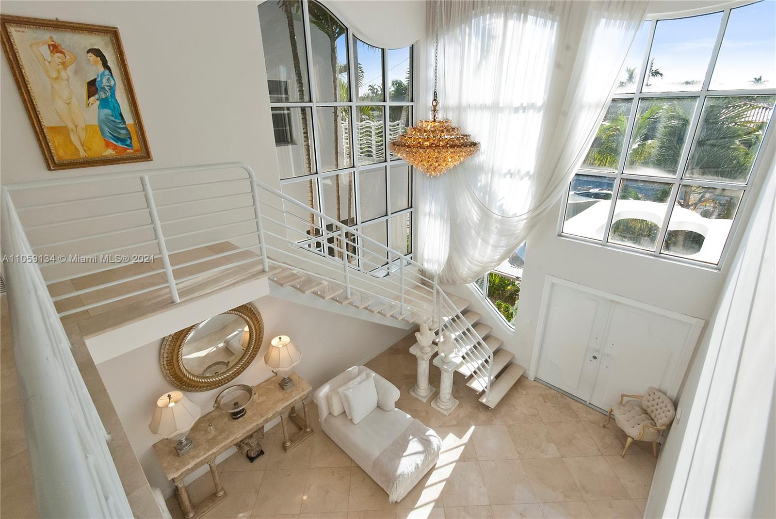 Contemporary Kobi Karp designed two story waterfront in sought after Bay Harbor Islands. Home features 24 foot ceilings and an open floor plan allowing for lots of natural light. Enjoy the beautiful water views from the four custom wave balconies and tropical salt water pool/Jacuzzi. There is a total of three suites and five baths plus cabana bathroom, study/office with wood library, wet bar and gym. Features guest or maid's room with separate entrance. Easy to and only house available for sale on the water in bay harbour!!!