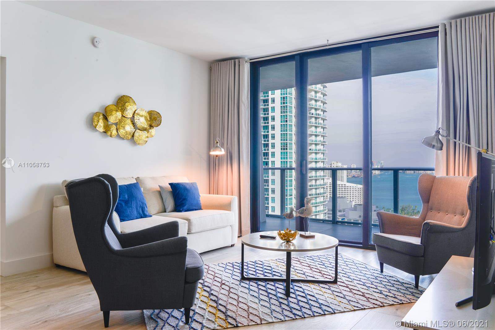 Spectacular upgraded unit at the iconic 1010 Brickell Condo. Professionally furnished apartment, 2 beds, 3 baths, plus Den, private elevator, high ceilings, huge balcony with stunning views, top of the line Smeg appliances! Building offers: outdoor movie theatre, restaurant & swimming pool @ 50th floor roof top; Co-ed Hammam spa w cold & hot Jacuzzi, massage & treatments rooms, sauna & steam room; basketball & racquetball courts, running track, indoor heated swimming pool, fitness center, party room w kitchen, open terrace & barbeque, kids room w bowling, virtual golf, among others. Excellent location next to public transportation, Brickell City Centre, & more.