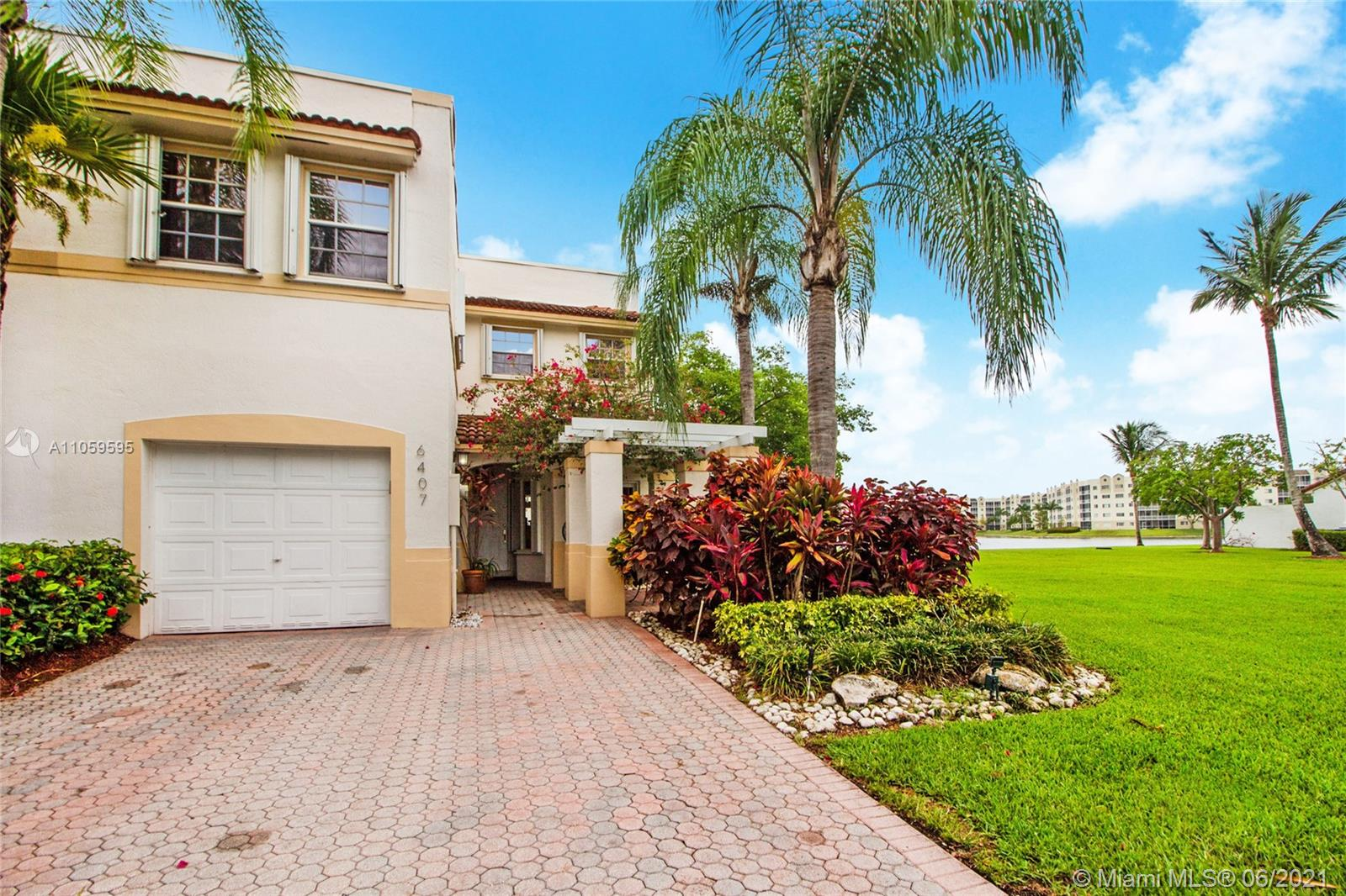 The most spectacular townhouse in Doral Isles. 3 bedrooms, 3 full bathrooms, one of them downstairs. Corner unit, beautiful lake view, marble floors, high-end appliances, covered patio, high-impact sliding glass doors to patio, garage converted into amazing home office, two parking spaces driveway. Short walking distance to Doral Isles' soccer and baseball fields, basketball and tennis courts, jogging trail, gorgeous Island Club with three pools, restaurant, fishing pier and gym.