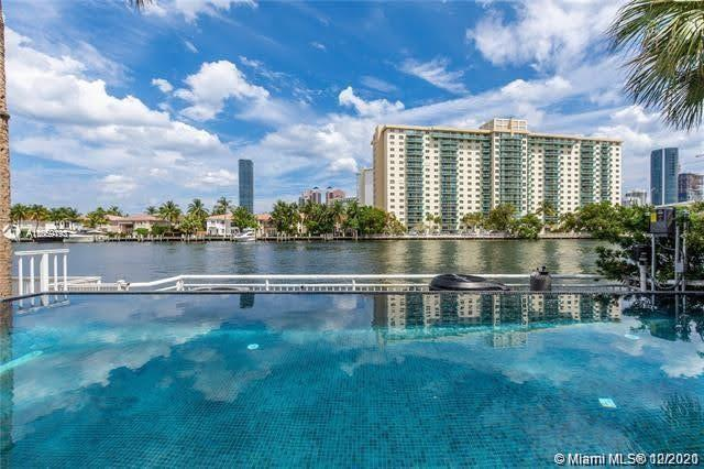RARELY AVAILABLE. FRESHLY PAINTED LUXURY 3 STORY WATERFRONT HOME! WITH NEW INFINITY POOL.. NEW ROOF.. ALSO HAS COMMUNITY POOL.. TENNIS NEXT DOOR. STEPS AWAY FROM SAFRA.   A MUST SEE !!! 5400 Sq.Ft