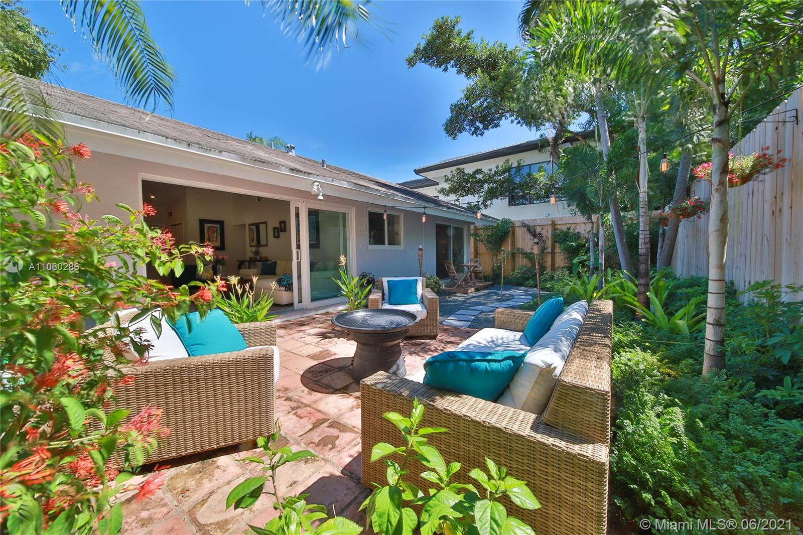 One of a kind, free-standing home in the heart of Coconut Grove. Ultra private & gated, this 2 bed / 2 bath charming home is a gem. Features an open kitchen with quartz countertop and stainless steel appliances, a fenced backyard, vaulted ceilings, and impact windows throughout. Beautiful backyard and landscaping. Washer/ Dryer inside. Two parking spots included! No HOA or approval required. No Flood Zone (X). Close to Cocowalk, restaurants, shops, dog park. A-rated elementary school district. Minutes away to Downtown, Brickell, Miami Airport, Coral Gables, Key Biscayne & the Beaches.