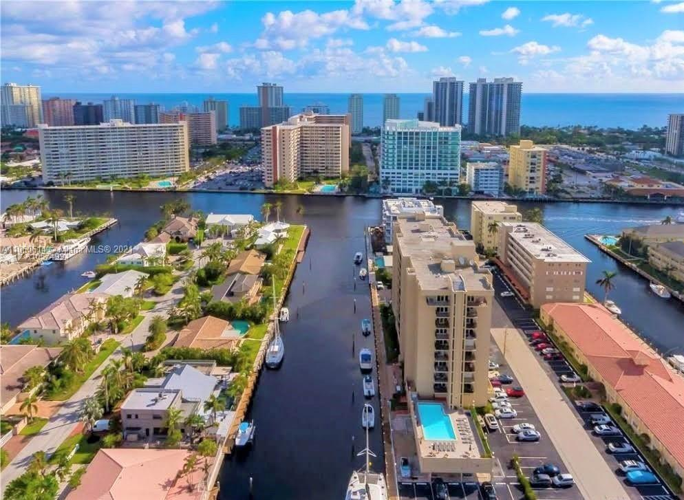 ATTENTION! BOAT LOVERS, DON'T MISS THIS OPPORTUNITY. SPACIOUS 2 BEDROOMS/2 BATHS WATERFRONT CONDO. AVAILABLE DOCK SPACE FOR UP TO 35FT BOAT WITH FREE OCEAN ACCESS, NO FIXED BRIDGES, JUST OFF THE INTERCOASTAL. A BLANK SLATE JUST WAITING TO BE FILLED WITH YOUR WARM HOME DECOR IDEAS TO PUT FLOORING, RENOVATE THE KITCHEN AND BATH, MAKE IT YOUR DREAM HOME. VERY BRIGHT CORNER UNIT, ON YOUR COMFORTABLE PRIVATE BALCONY YOU CAN ENJOY THE CANAL AND THE POOL VIEW WHILE YOU SIPPING YOUR FAVORITE DRINK AND WATCHING THE STUNNING SUNSETS IN EVERY EVENING. JUST MINUTES AWAY FROM THE BEACH, CLOSE TO RESTAURANTS, SHOPPING CENTERS, SHORT DRIVE TO DOWNTOWN AND AIRPORT. ALSO VERY CLOSE TO CORAL RIDGE COUNTRY CLUB, A DESIRABLE NEIGHBORHOOD. BRAND NEW A/C UNIT, ON-SITE MANAGER AND OFFICE.