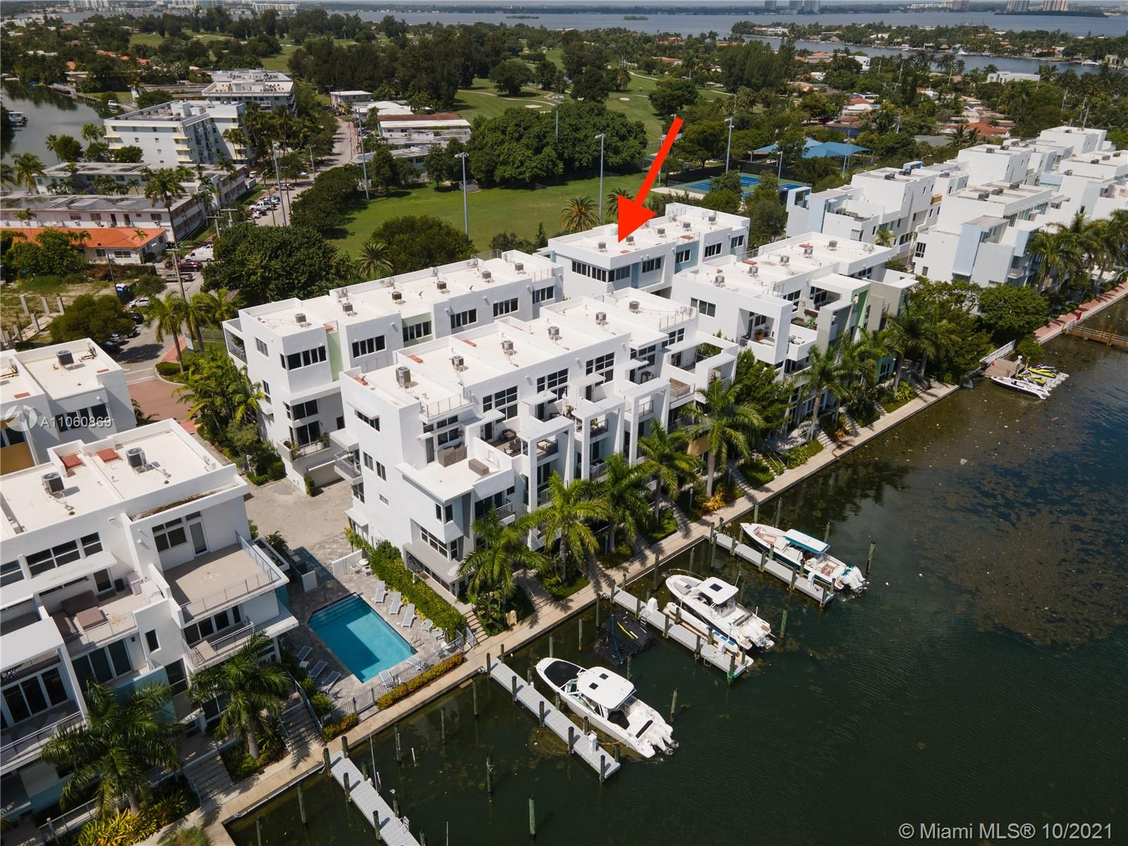 Stunning modern and spacious townhome in a gated community with private pool and Marina, minutes away from the beach. Private 2 car garage, elevator, and rooftop terrace with custom outdoor kitchen! Located on the highly desired Normandy Isle, this 3bd 3.5 ba includes: smart home tech, whole house water filtration system, motorized shades, electric car charger, & plenty of storage and built out closet space. Townhouse is situated on a quiet and private street with an 18-hole golf course, tennis & basketball courts, children's playground, & Fairway Park all right outside your front door. Solid reinforced concrete building with impact resistant windows, intercom, laundry room, open concept kitchen with stainless steel appliances and GAS cooktop. Low HOA dues. Great investment opportunity
