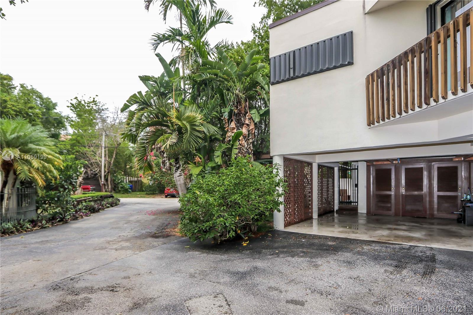 """Authentic Coconut Grove.  Situated East of SW 27 Ave, on a quite no traffic street, this townhouse with no HOA fee is oozing with style and possibilities. Upon entering you will find tons of charm and natural light with panoramic views of the over-sized well foliated wrap around yard, surrounded by an 8 foot privacy wall for enjoyable indoor outdoor living. At over 1600 Square feet. this unit offers volume ceilings, a custom WBFP, Two Bedrooms, each with private bath, an in ground concrete jacuzzi/pool and covered parking. If you have been looking for a true Town-Home with wonderful neighbors in the best N. Grove """"walking"""" neighborhood you have finally found it. Please see Broker comments for showing and access information. 24 hrs notice required."""