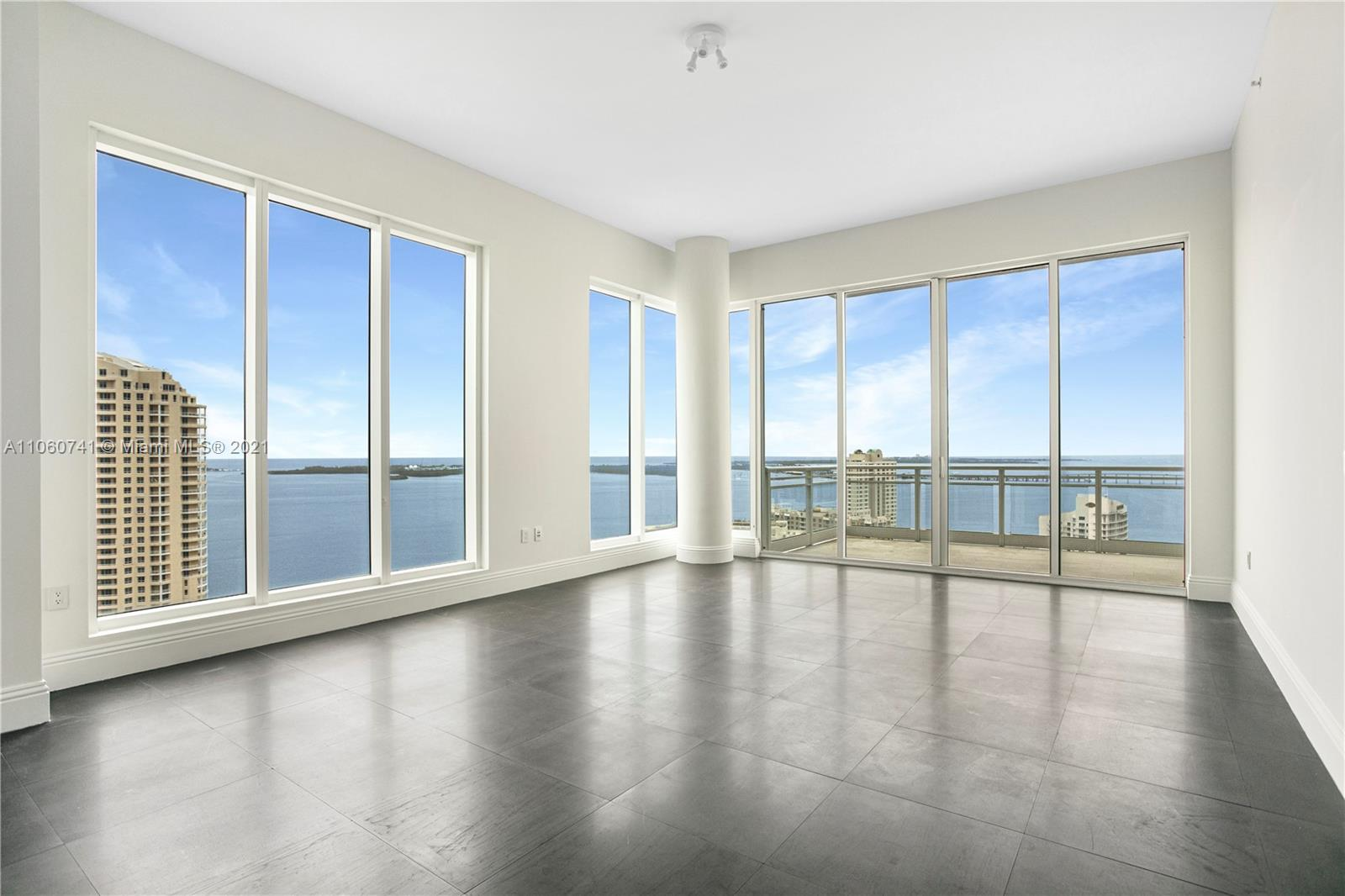 Stunning unit in Asia, in exclusive Brickell Key Island! Corner unit features 180-degree breathtaking view of the Ocean, Biscayne Bay and Miami's lively exciting skyline. Private elevator entrance, 12 -foot ceiling. You will witness every day's beautiful sunrise and sunset from each of its four large balconies. Gourmet Kitchen has Italian countertop, wine cooler, and built-in espresso machine. Miele oven complements the subzero refrigerator with integrated microwave and ceramic cooktop. 2 assigned parking spaces and storage included. The building amenities include a 24/7 concierge, tennis and basketball/racquetball court, swimming pool, jacuzzi, gym and party room. The island offers a convenience store, dry cleaning and hair salon. Easy access to the islands walk/run path.