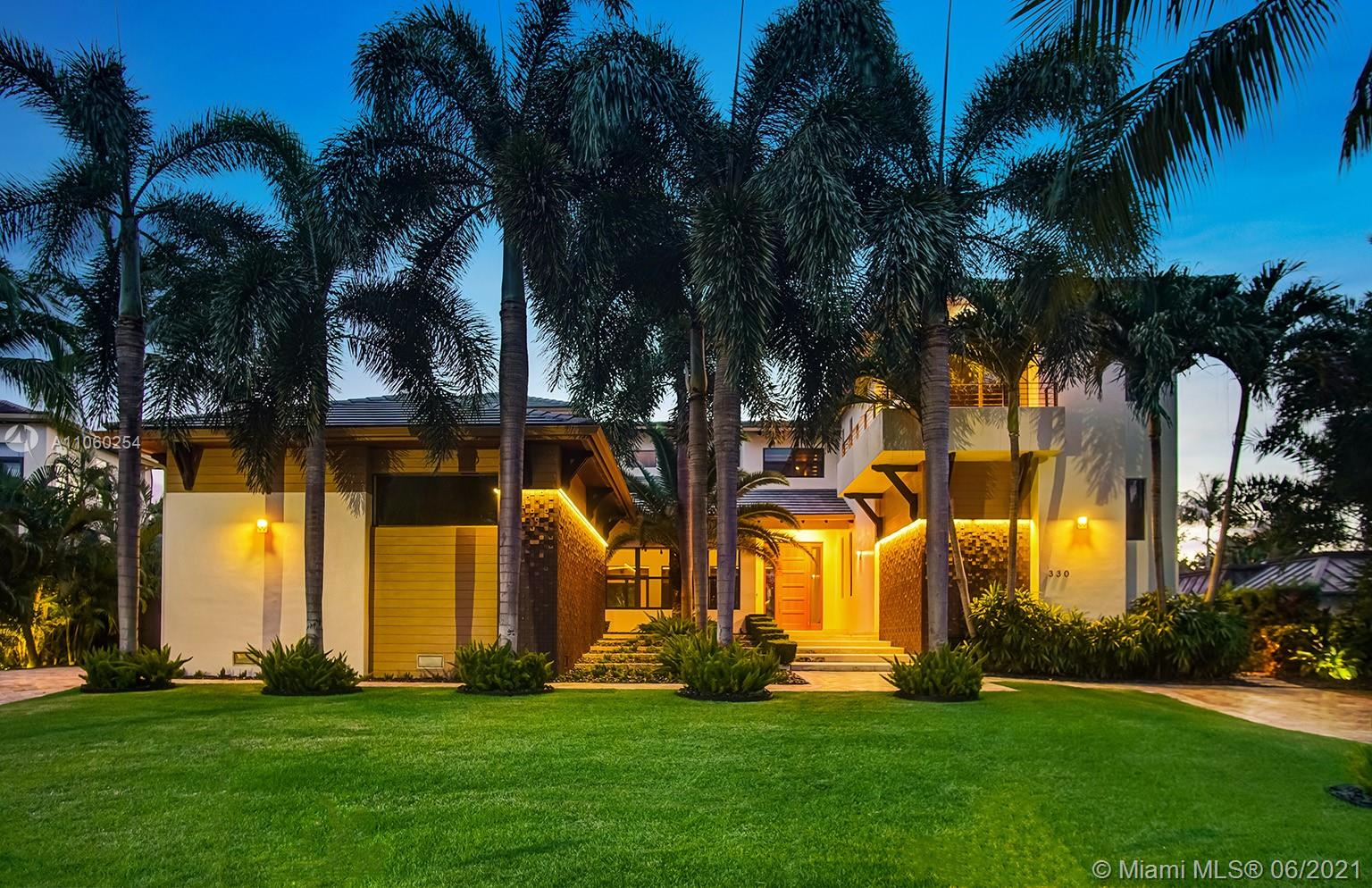"""330 Caribbean is a High-end Balinese Modern Home which sits on an oversized 12,262 Sq Ft. lot just 4 blocks (A 4-minute walk) from the beach and across the street from the Village Green Park. This 5,528 Sq Ft under air home with 2 car garage (not counted in the square footage) exudes quality not found in any builder """"spec"""" home on the Key. The 6 Bedroom 7 full bath home (inclusive of a separate nannies quarters) has refinished rich dark woods throughout and was just completely updated inside and out. From a matte finished sleek bath and hardware to new Italian """"Tecla"""" vanities in select bathrooms, refinished woods and fresh matte white finished paint compliment the homes modern meets Balinese feel.  See proximity map, drone footage and 3D home tour on the web at 330Caribbean_Dot_Com"""