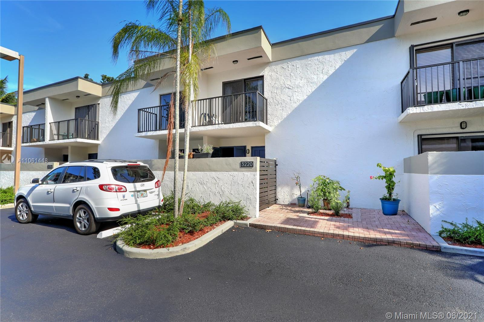 Beautifully updated 2-story Coconut Grove Townhome Condo with 2 Bed/2.5 Baths, balconies in every room, private fenced patio, all impact windows, Bamboo wood floors throughout, new AC & air ducts, renovated kitchen with wood cabinets & quartz counter tops, updated full bathrooms in both bedrooms with a half bathroom downstairs and a laundry room with large washer and dryer. The community is gated and within walking distance to Milam's Supermarket, Homedepot, Cocowalk and Metro Station.